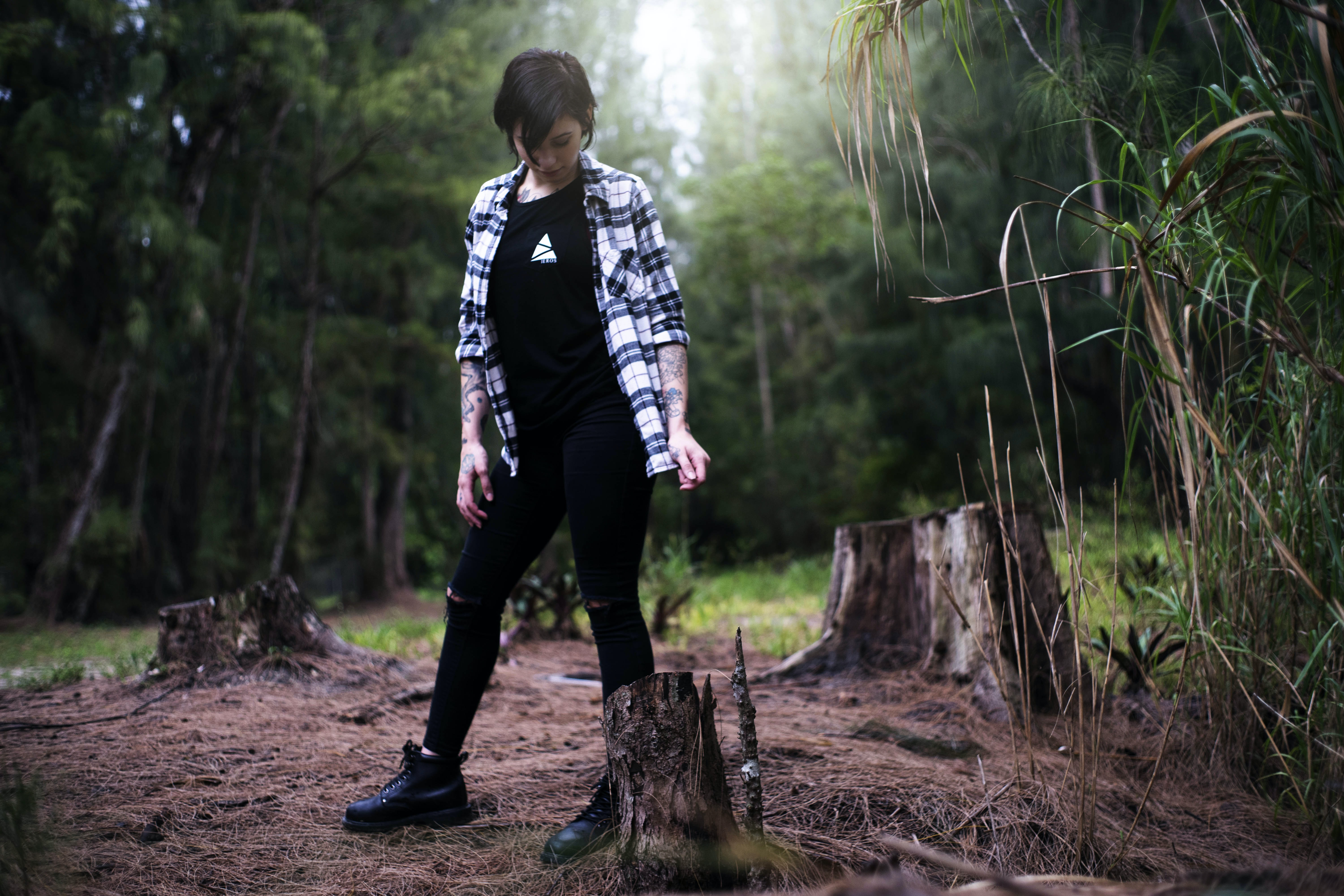 woman standing looking into log