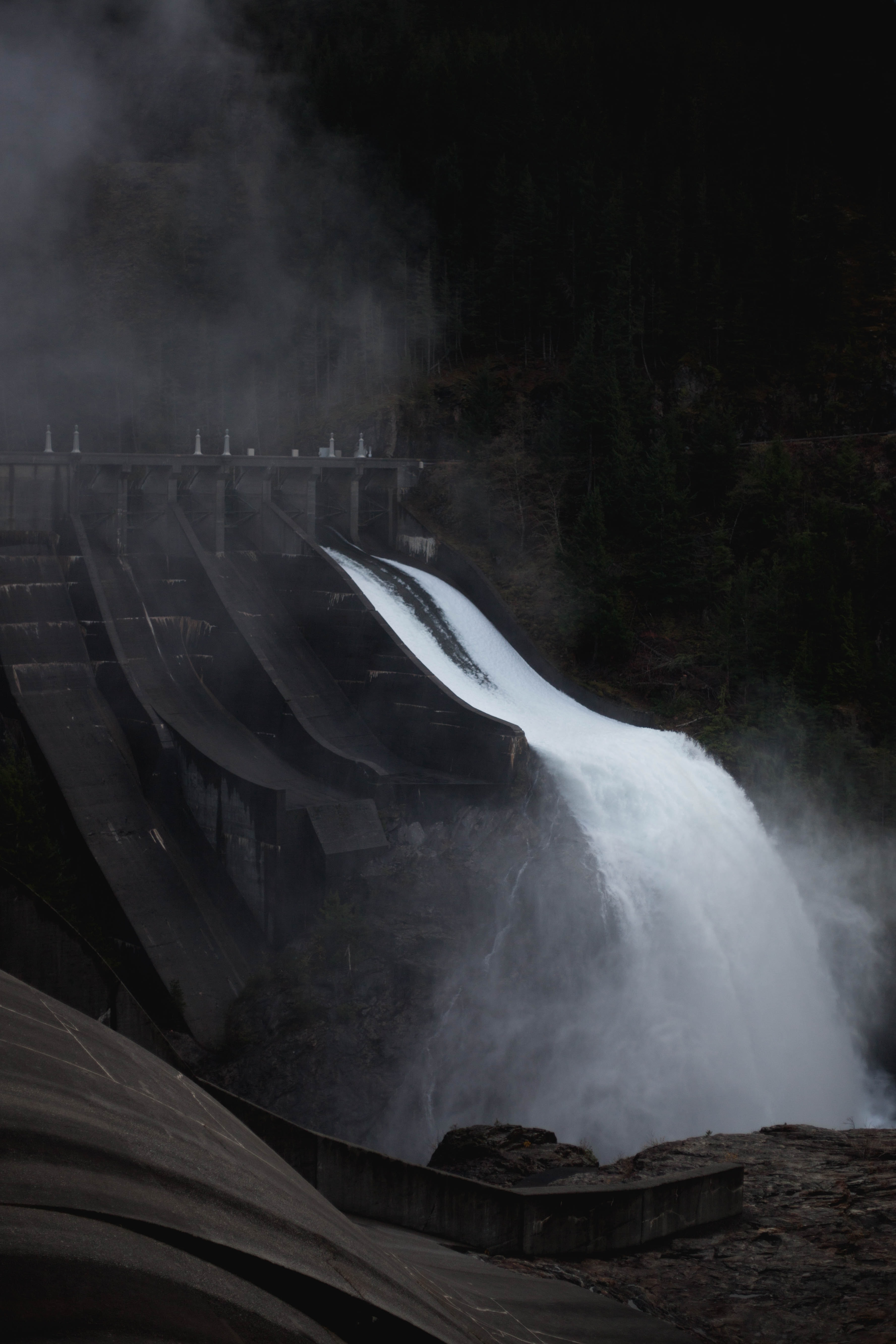dam pouring water during nighttime