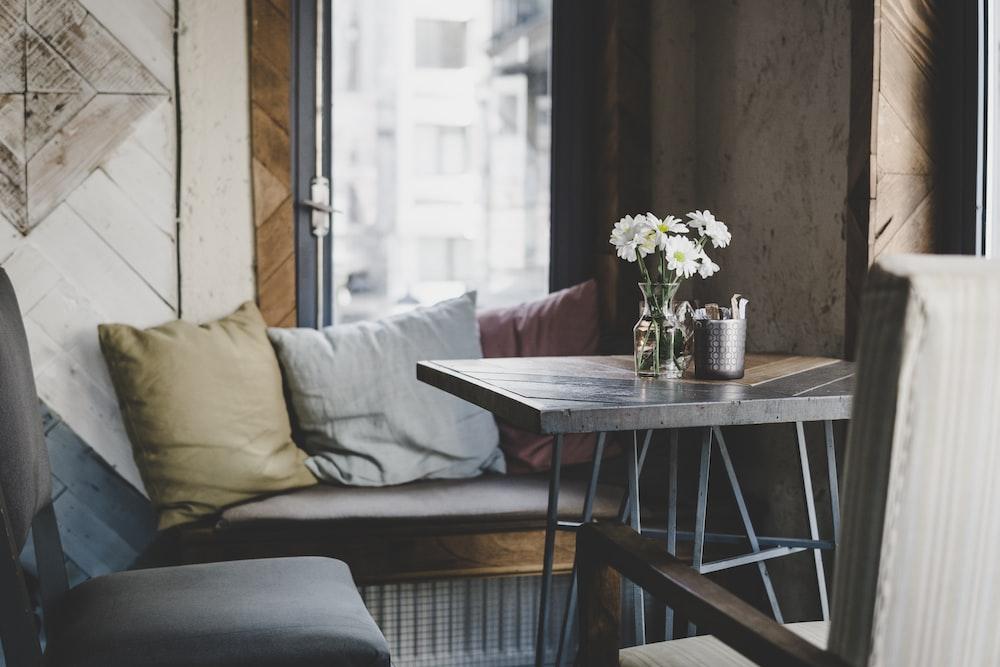 black wooden table near sofa