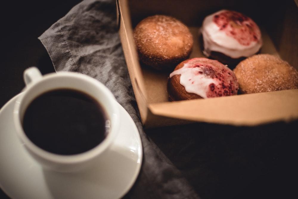 white teacup near bread