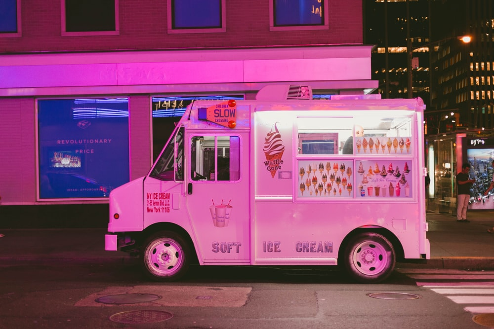white ice cream truck parked on road