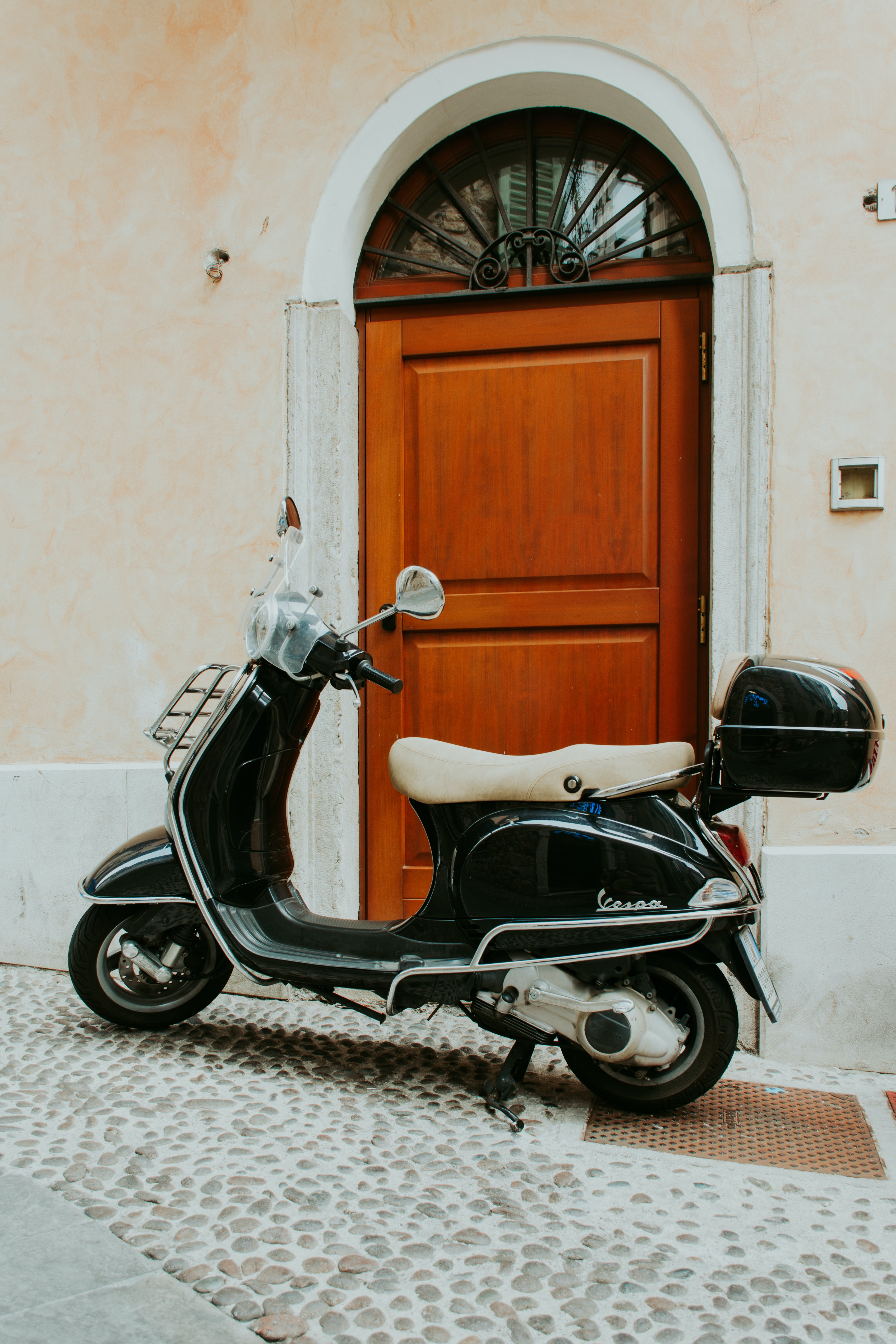 motor scooter parked near the door during day