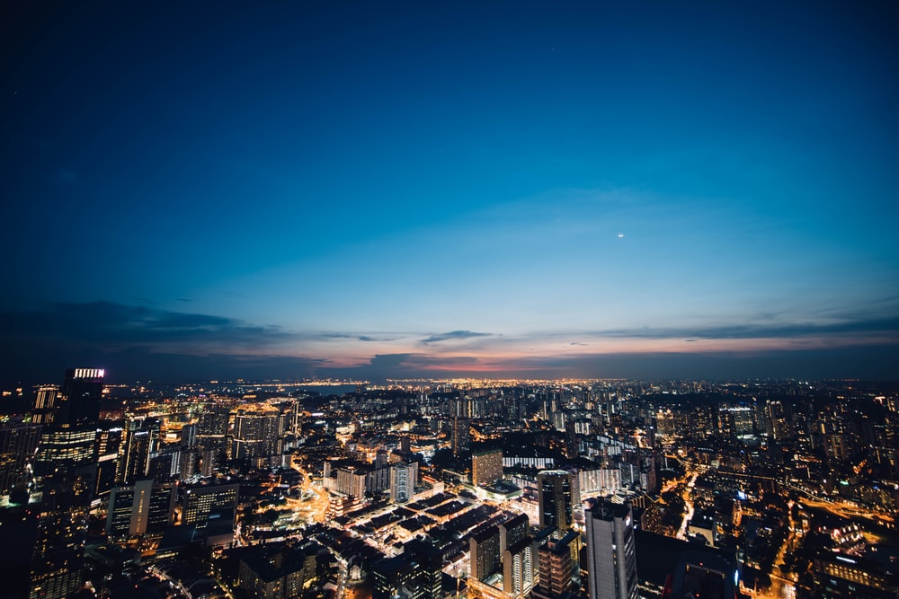 aerial photograph of city buildings at night