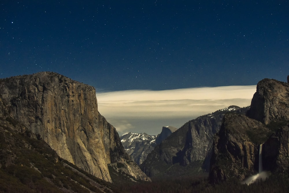 mountain ranges under cloudy sky