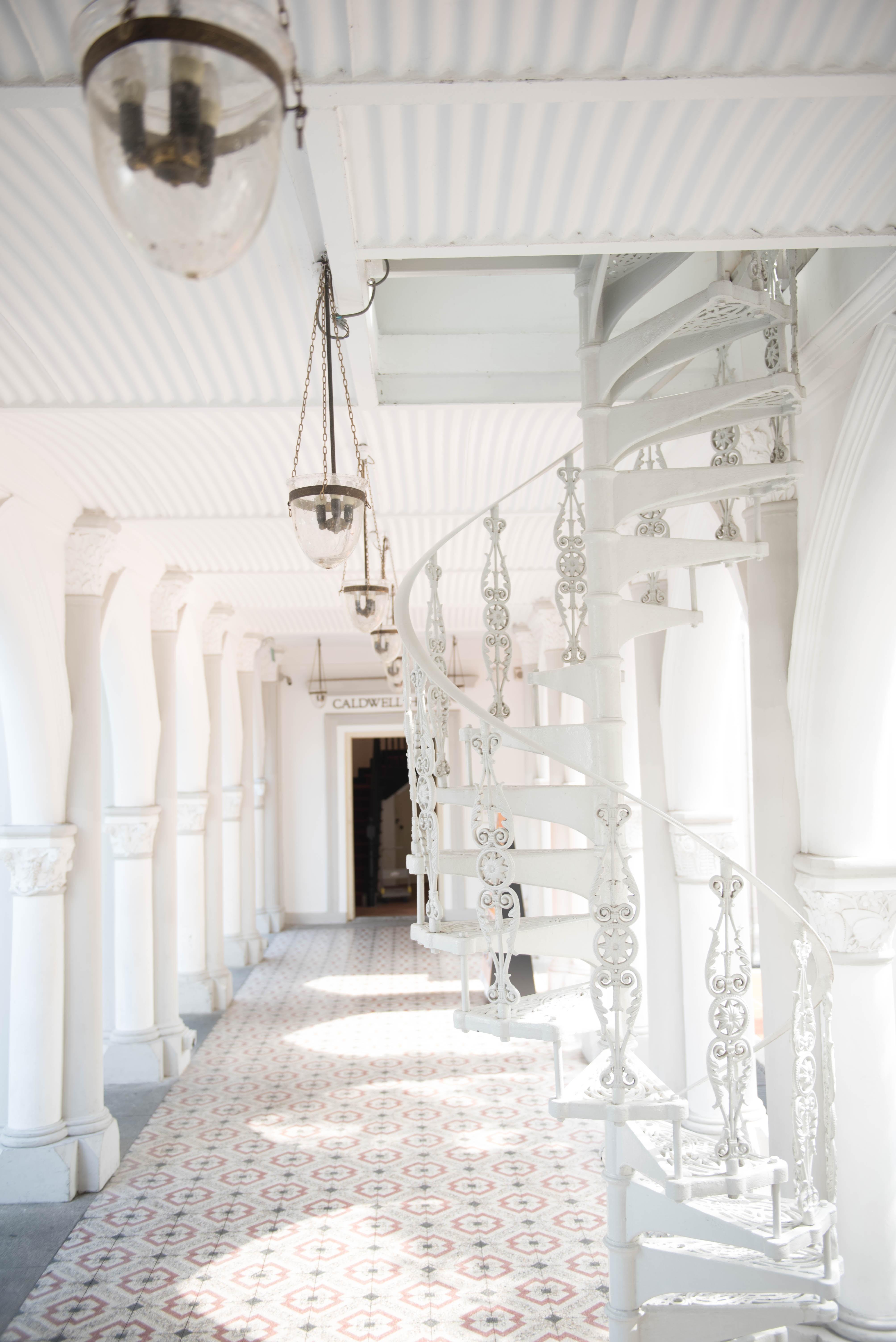 white hallway with ladder