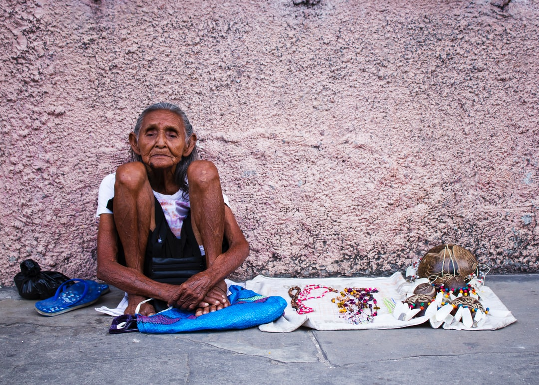 I was walking downtown in Iquitos, Peru, when I saw this older lady selling her crafts. It caught my attention the way how she sat  holding her legs towards her  as if subconsciously she was trying to hold her whole existence together.  I approached her and I gave her some money in exchange for some pictures of her. Confused, she agreed.  This picture reminds me of the strength and fragility of human existence. This lady called Emma, at ninety two, she still was fighting. Her quiet strength was worthy of my admiration.