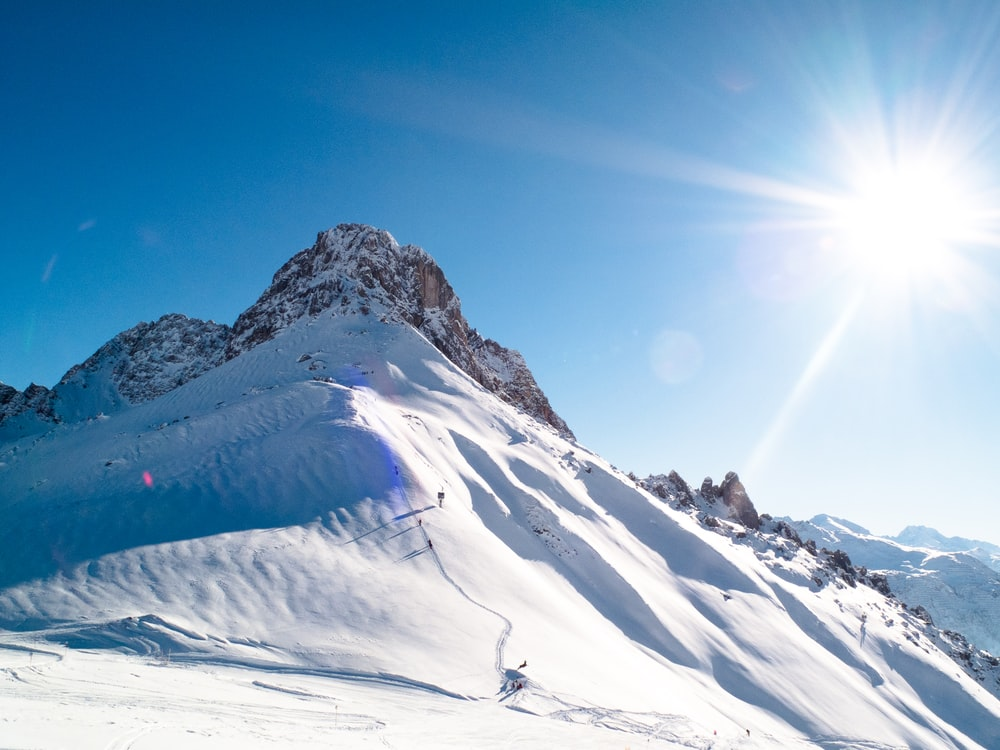 group of people snow skiing on mountains during daytime
