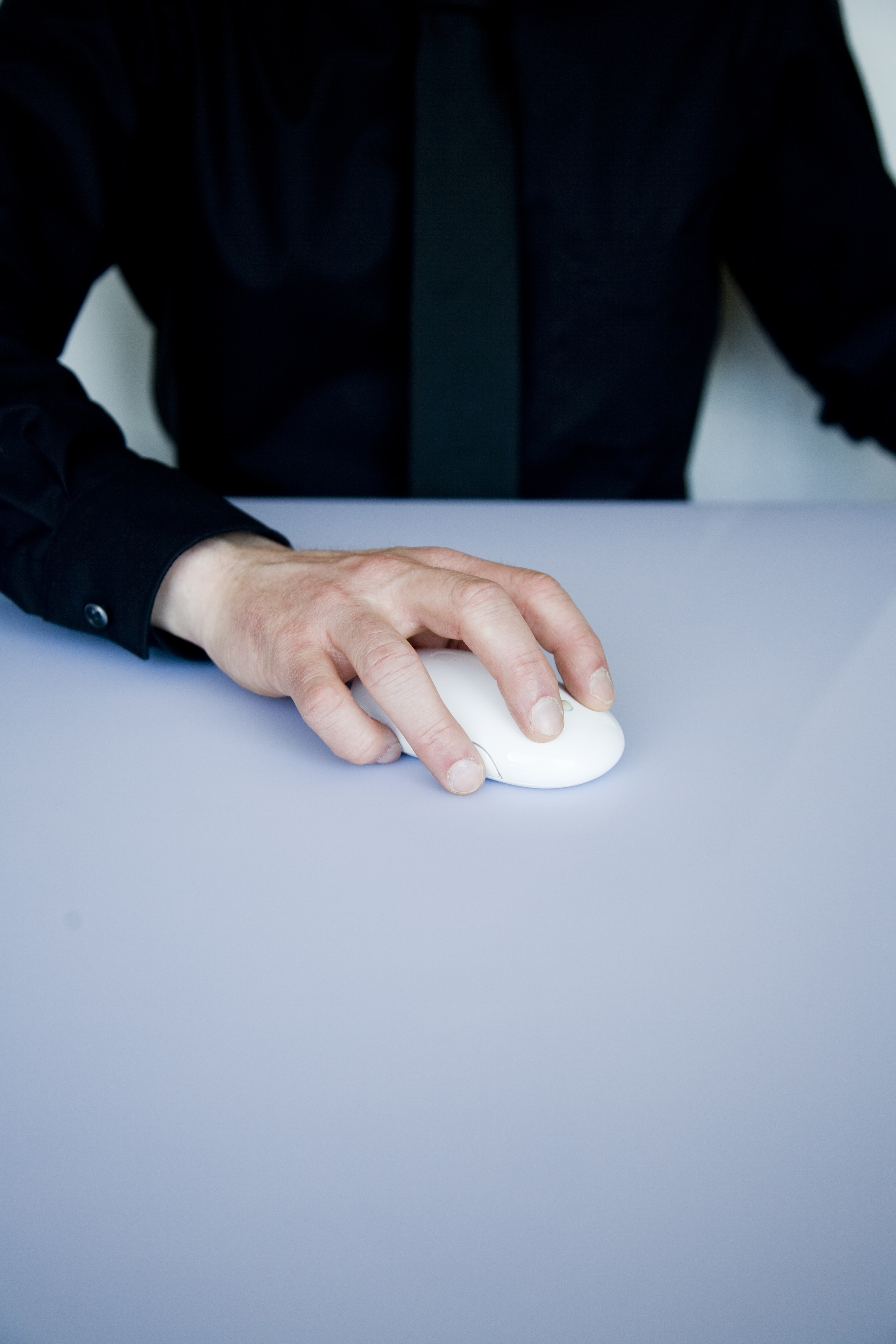 person holding white cordless computer mouse