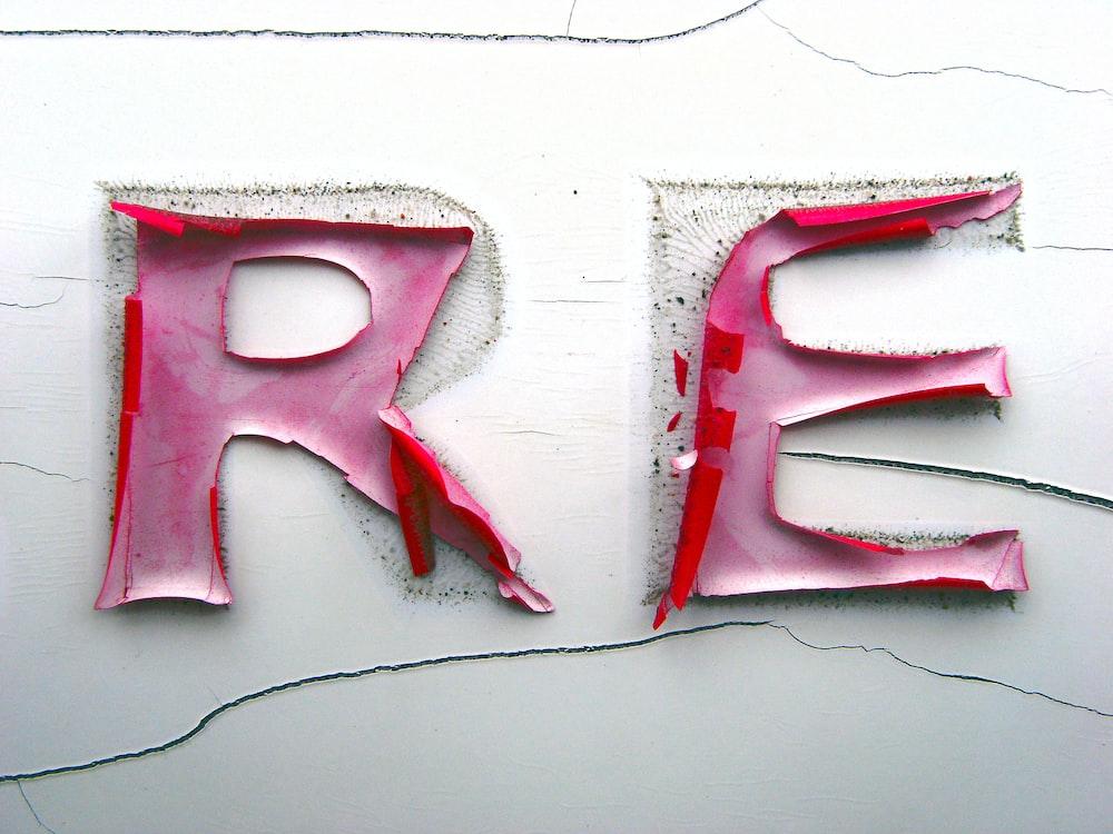 closeup photo of a R and E stickers
