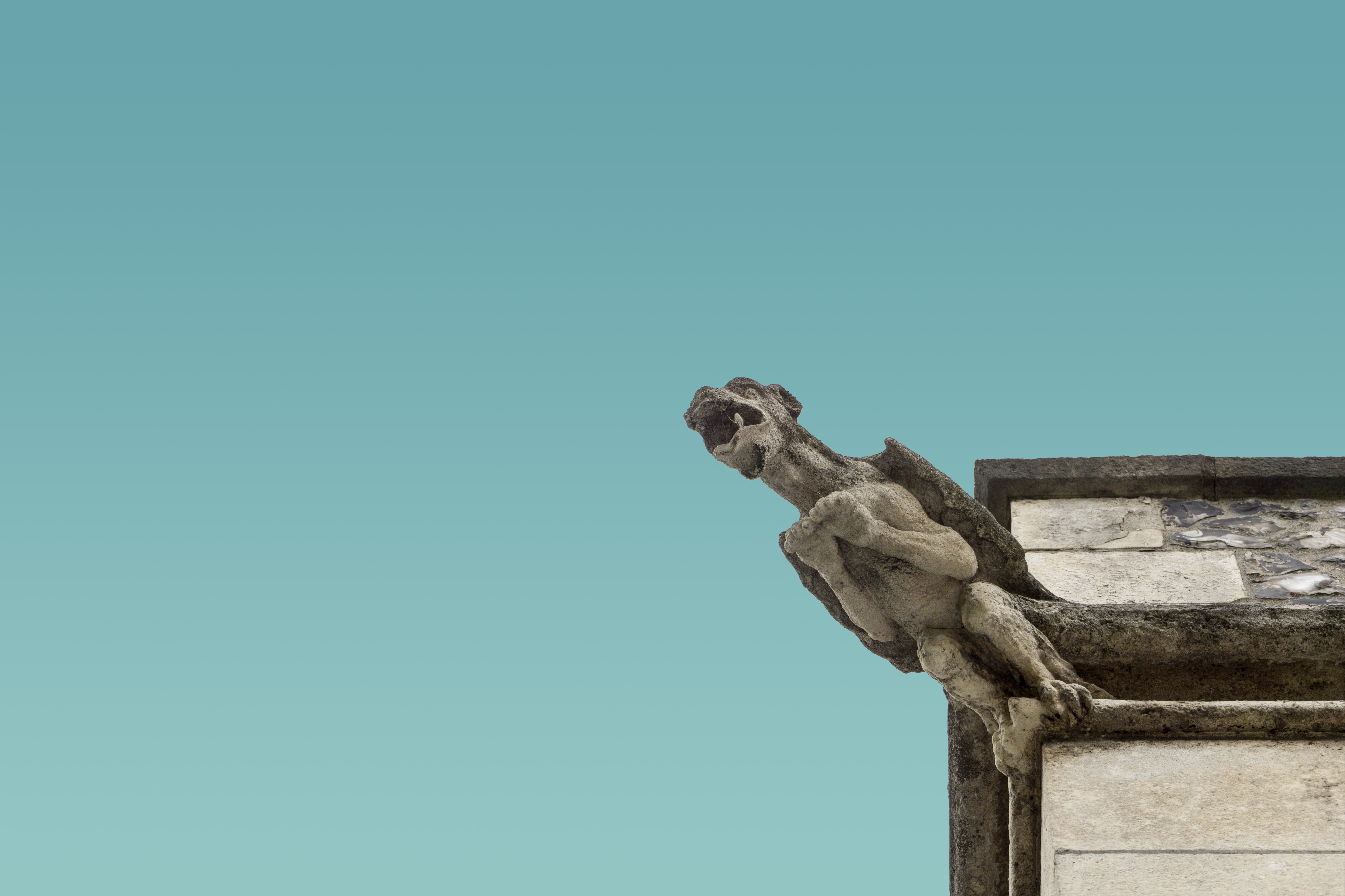 concrete gargoyle on structure edge