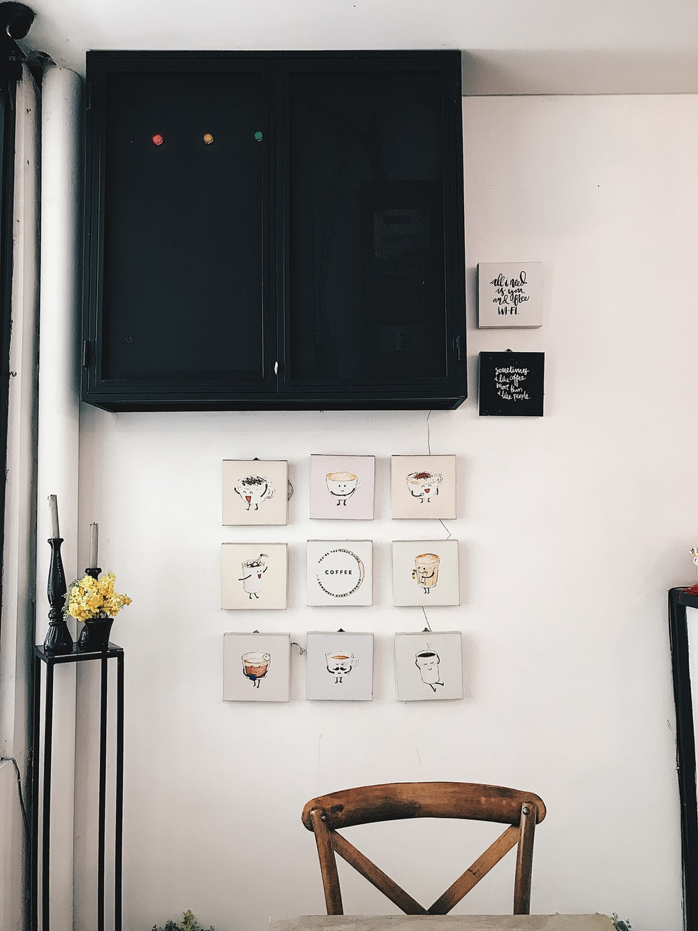 assorted-coffee square white black paintings under wooden cabinet inside room