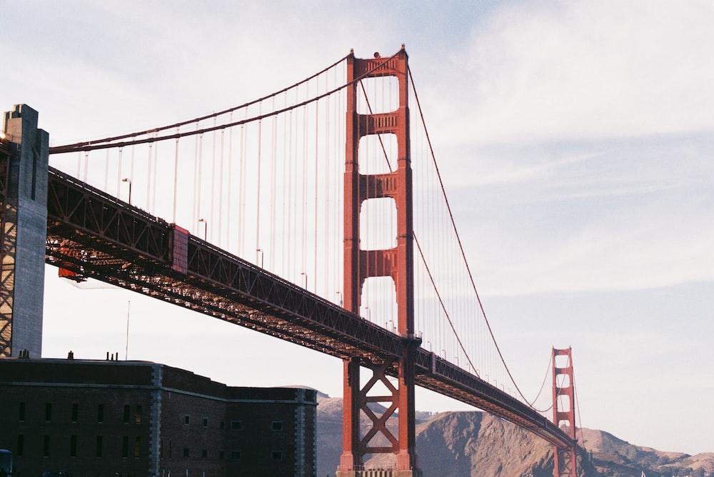 red and black bridge during daytime