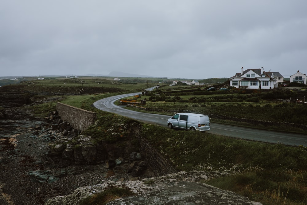 white panel van moving on grey curved road