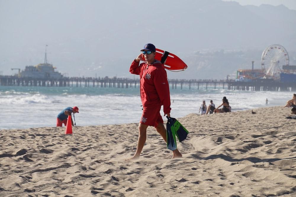 lifeguard walking in a sand shore