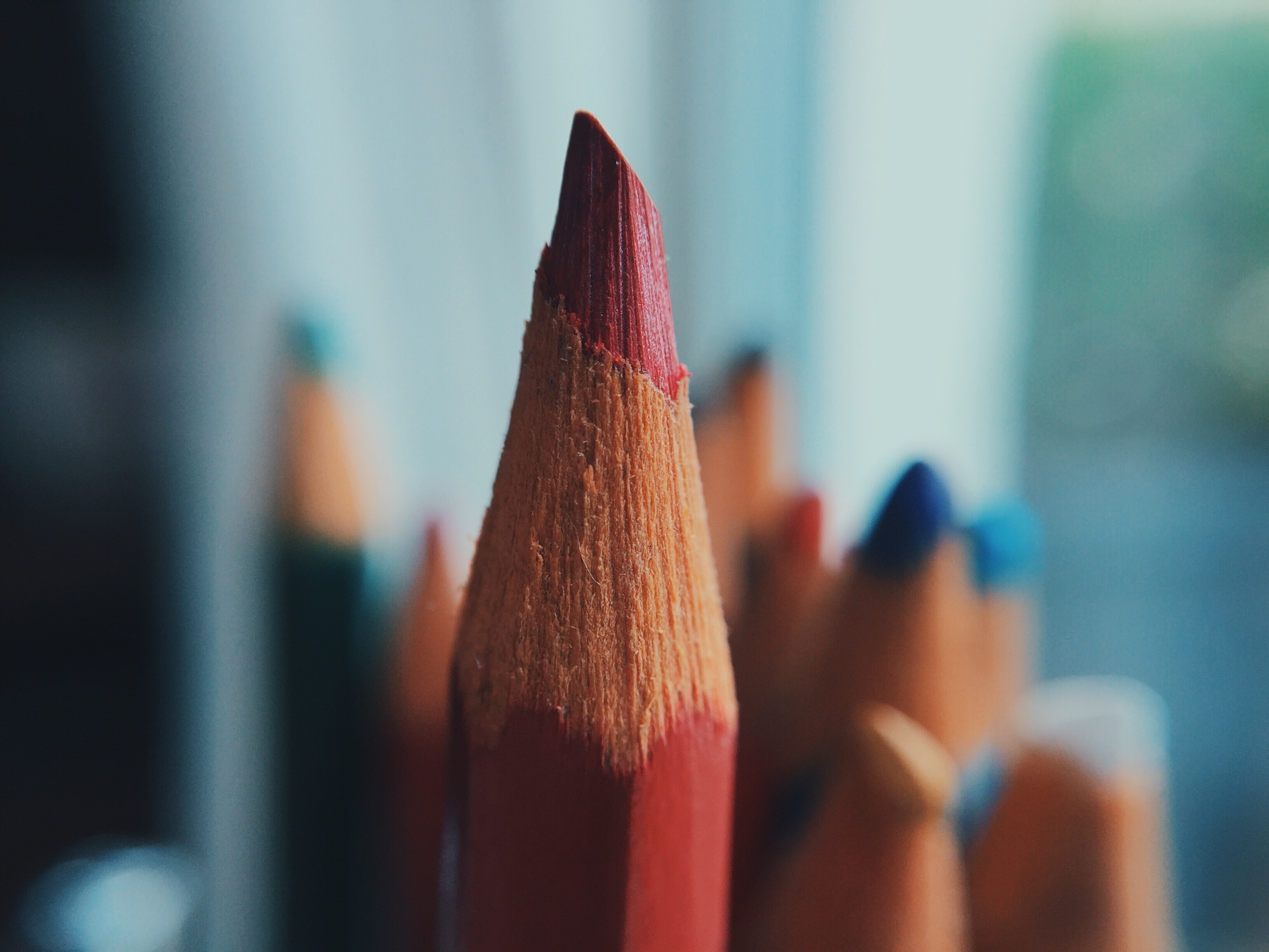 selective focus photography of red color pencil