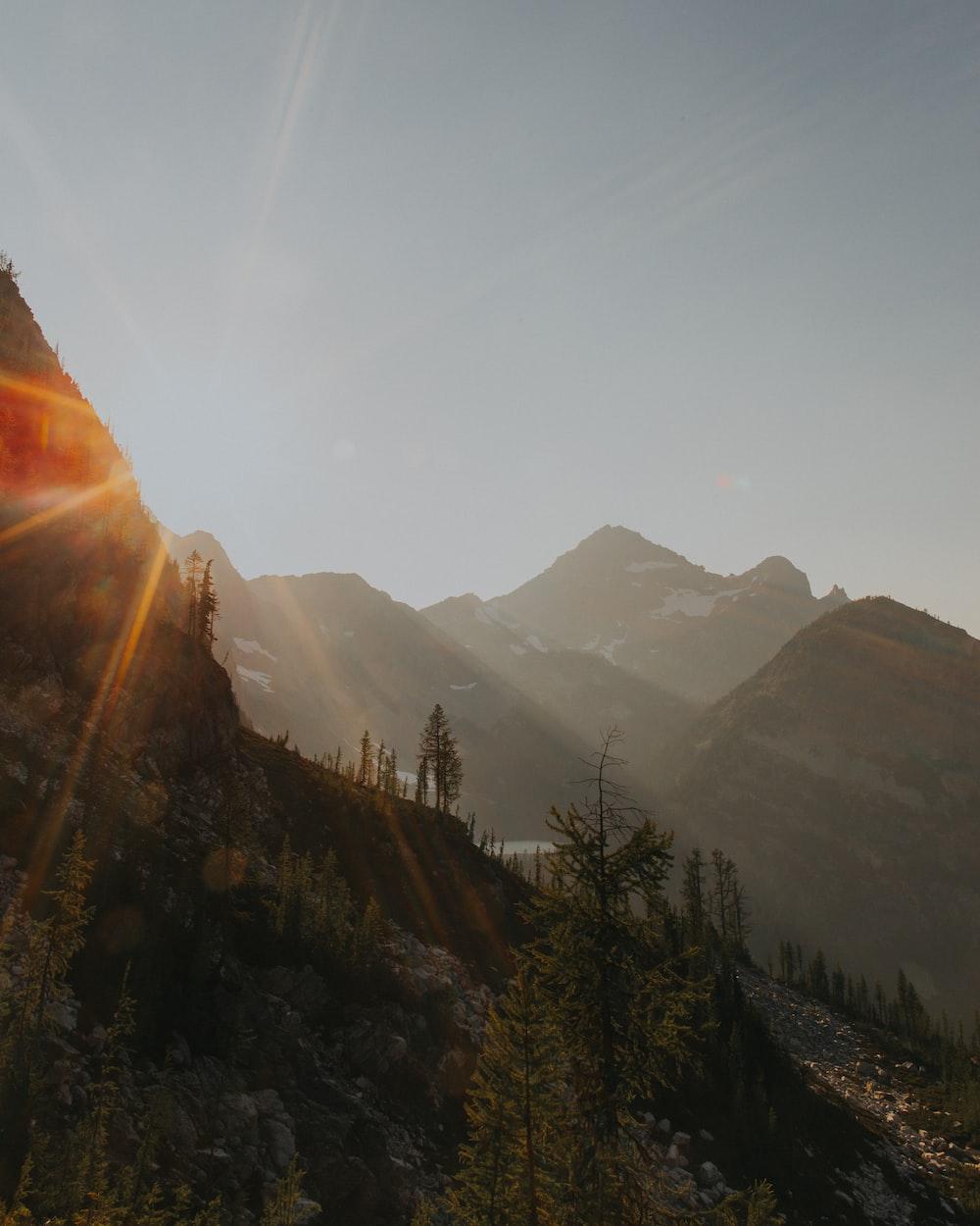 photo of mountain during sunrise