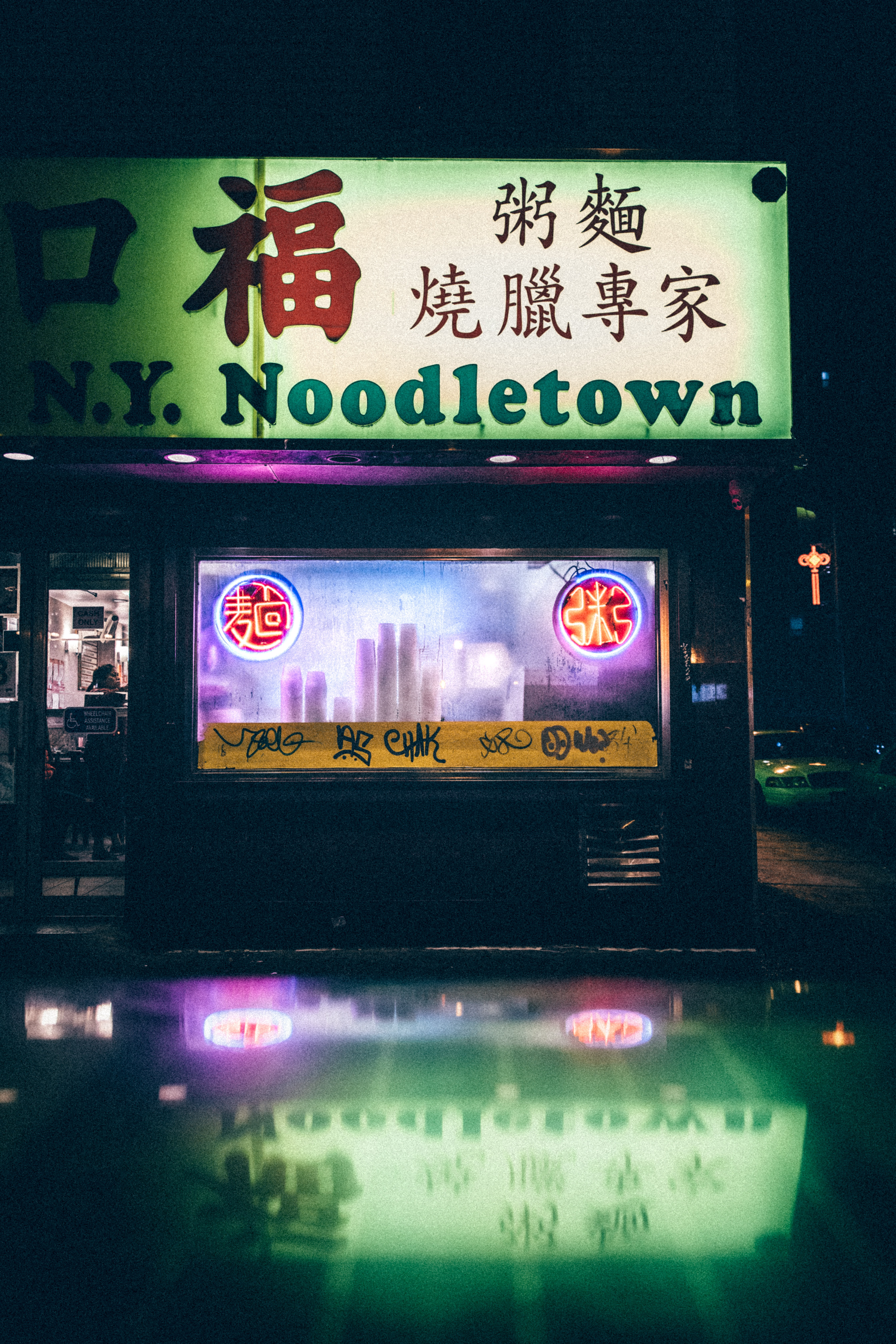 NY Noodletown building with signage at night time