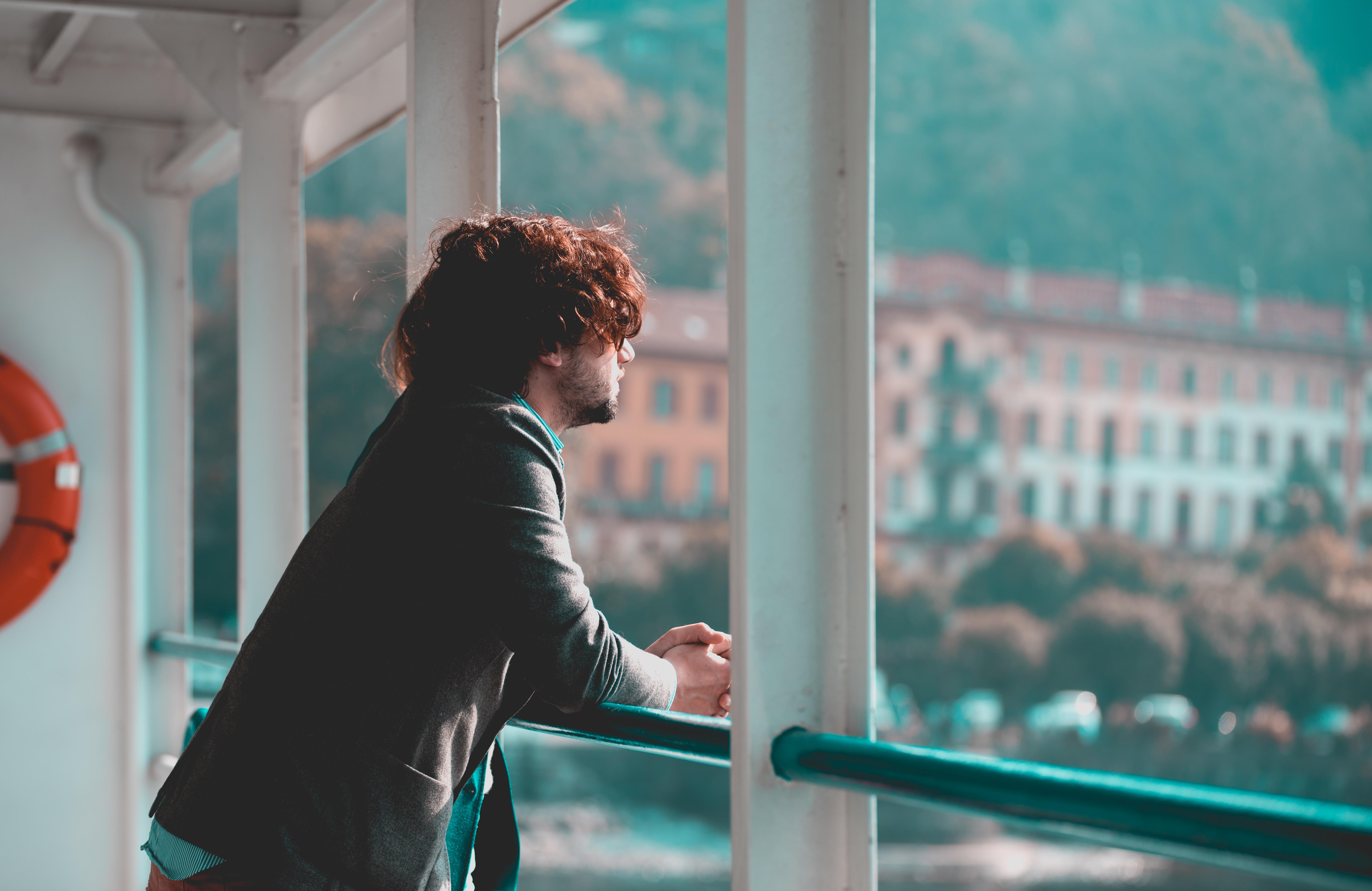 man sight seeing on window