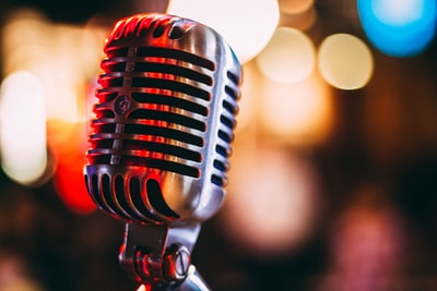 bokeh photography of condenser microphone music teams background