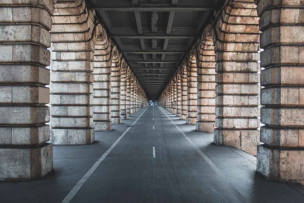 road between brown panels during daytime