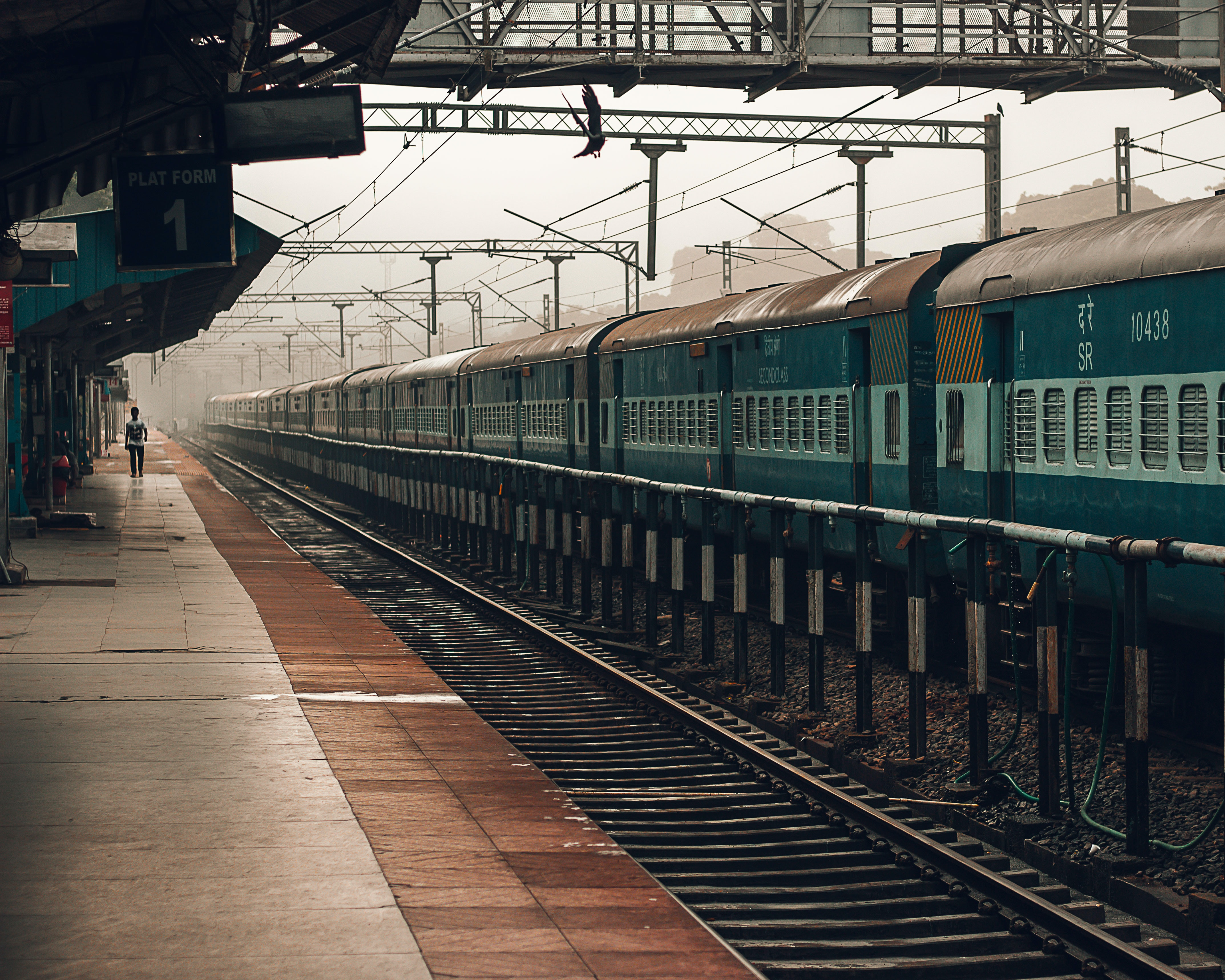 green train on station during daytime