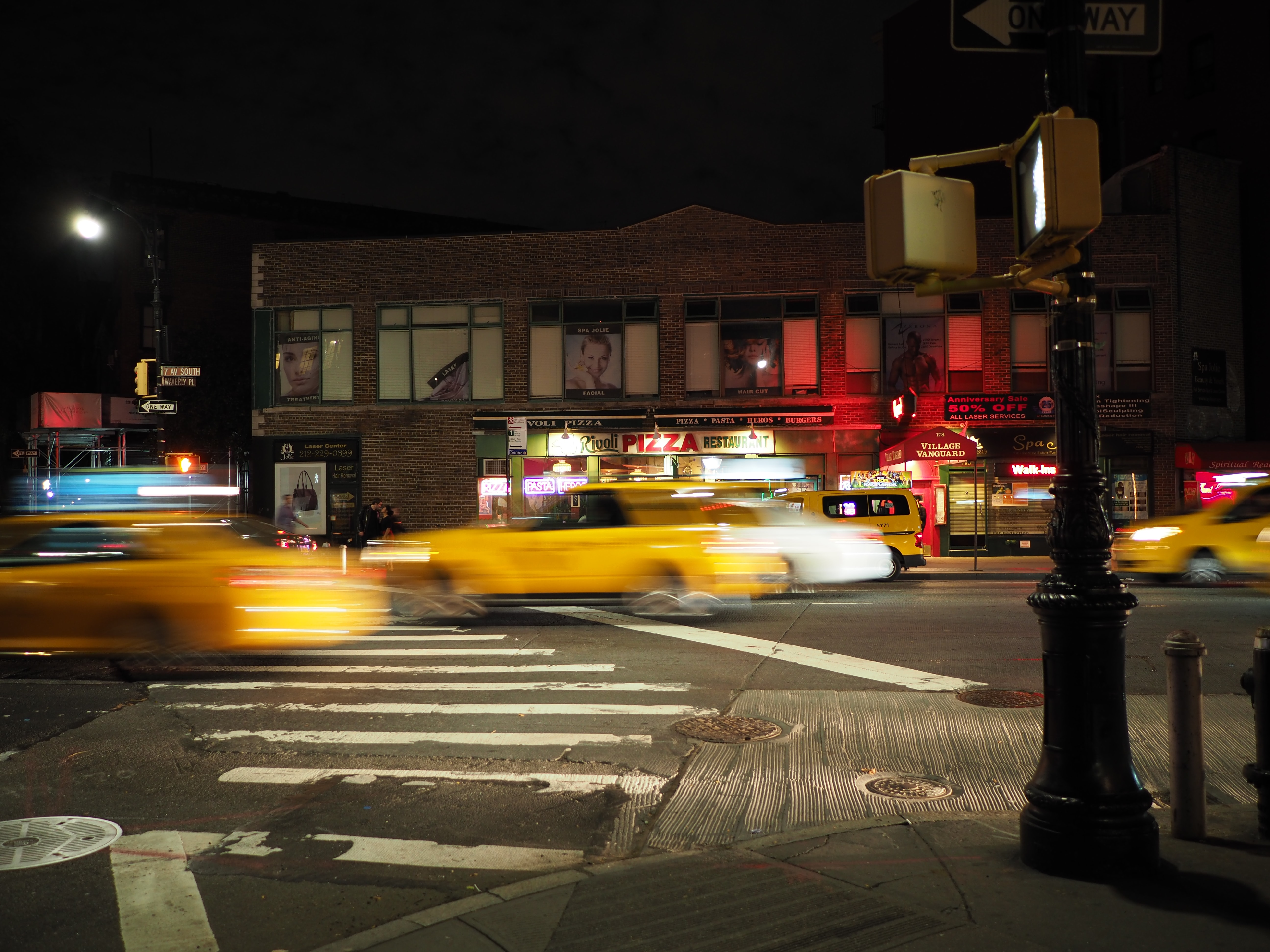 panning photo of cars on road during nighttime
