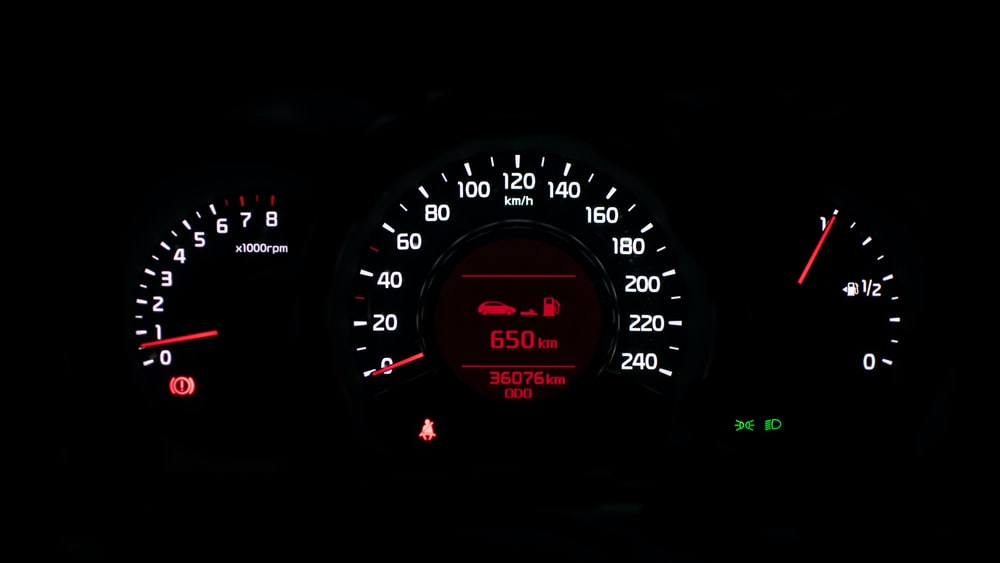 closeup photo of black car instrument cluster panel