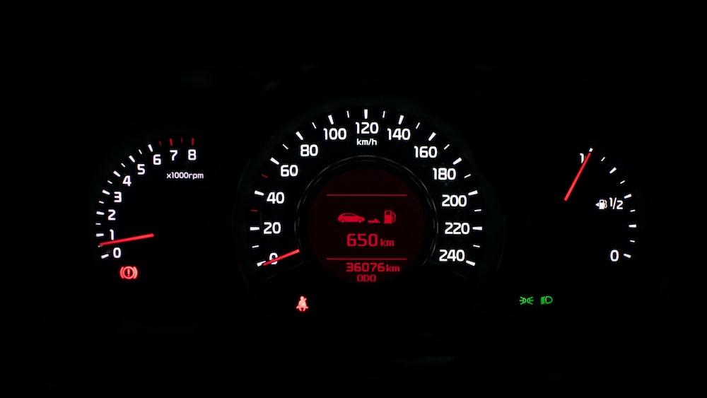closeup photo of black car instrument cluster panel