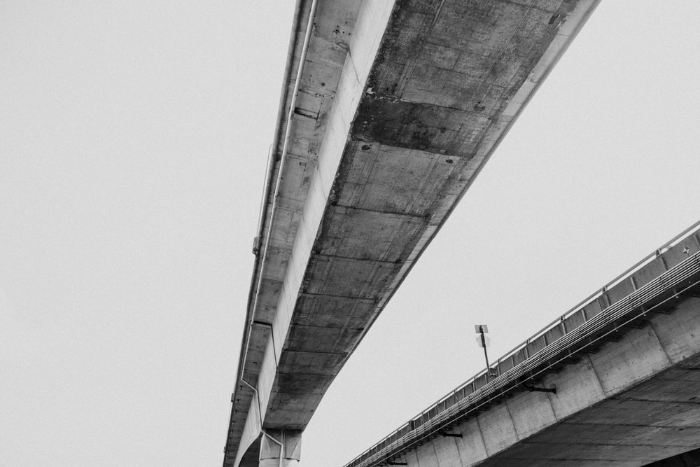 low-angle photo of concrete bridge