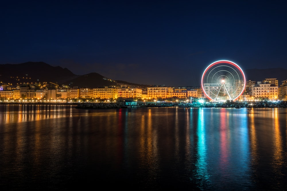 time-lapse photography of London Eye during night time