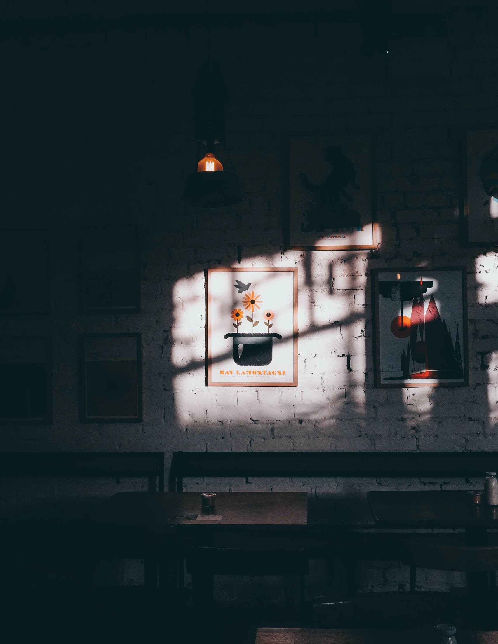 lights casting on photo frames in dark room