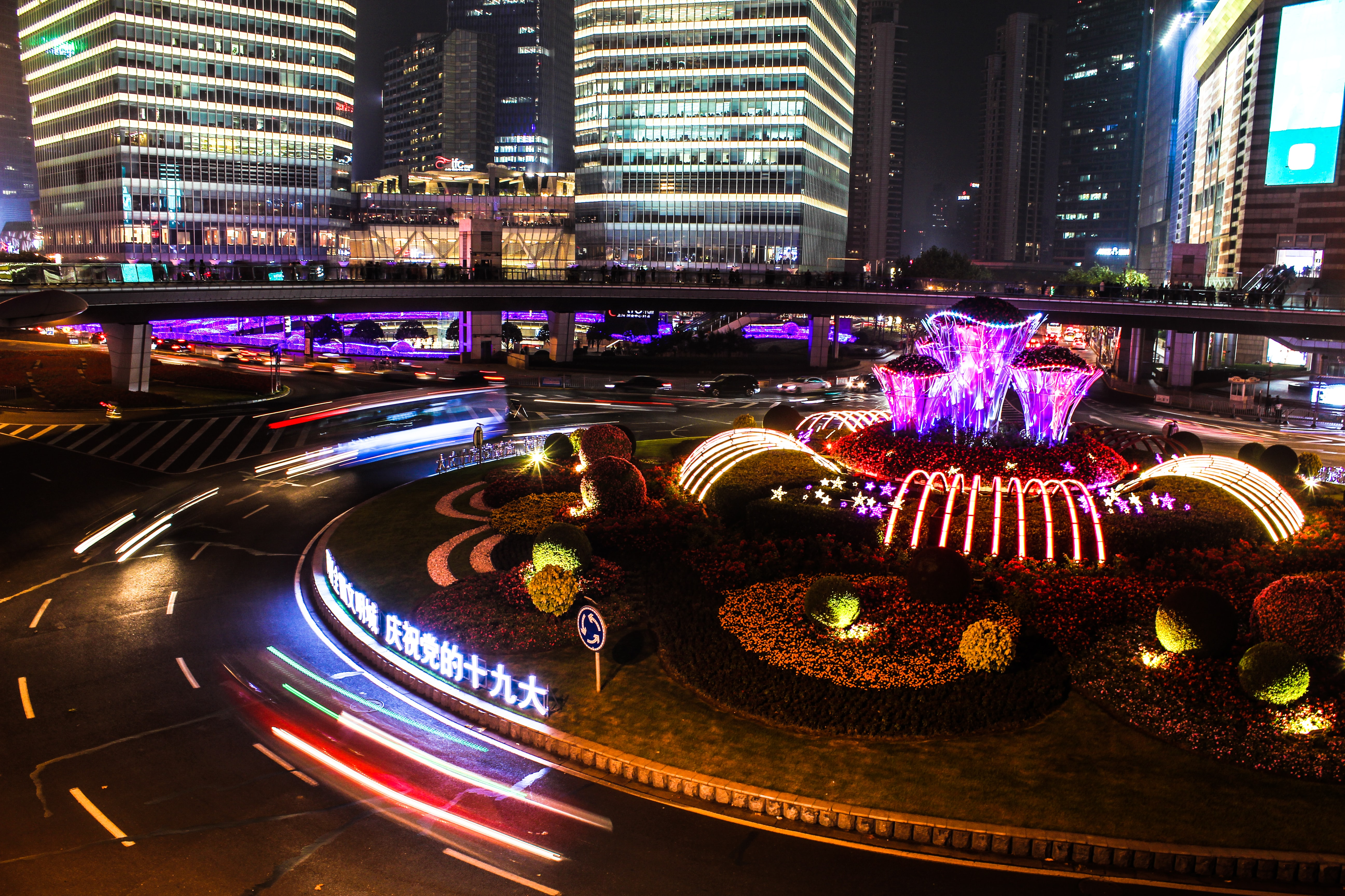 time-lapse photography of lighted fountain near buildings at night time