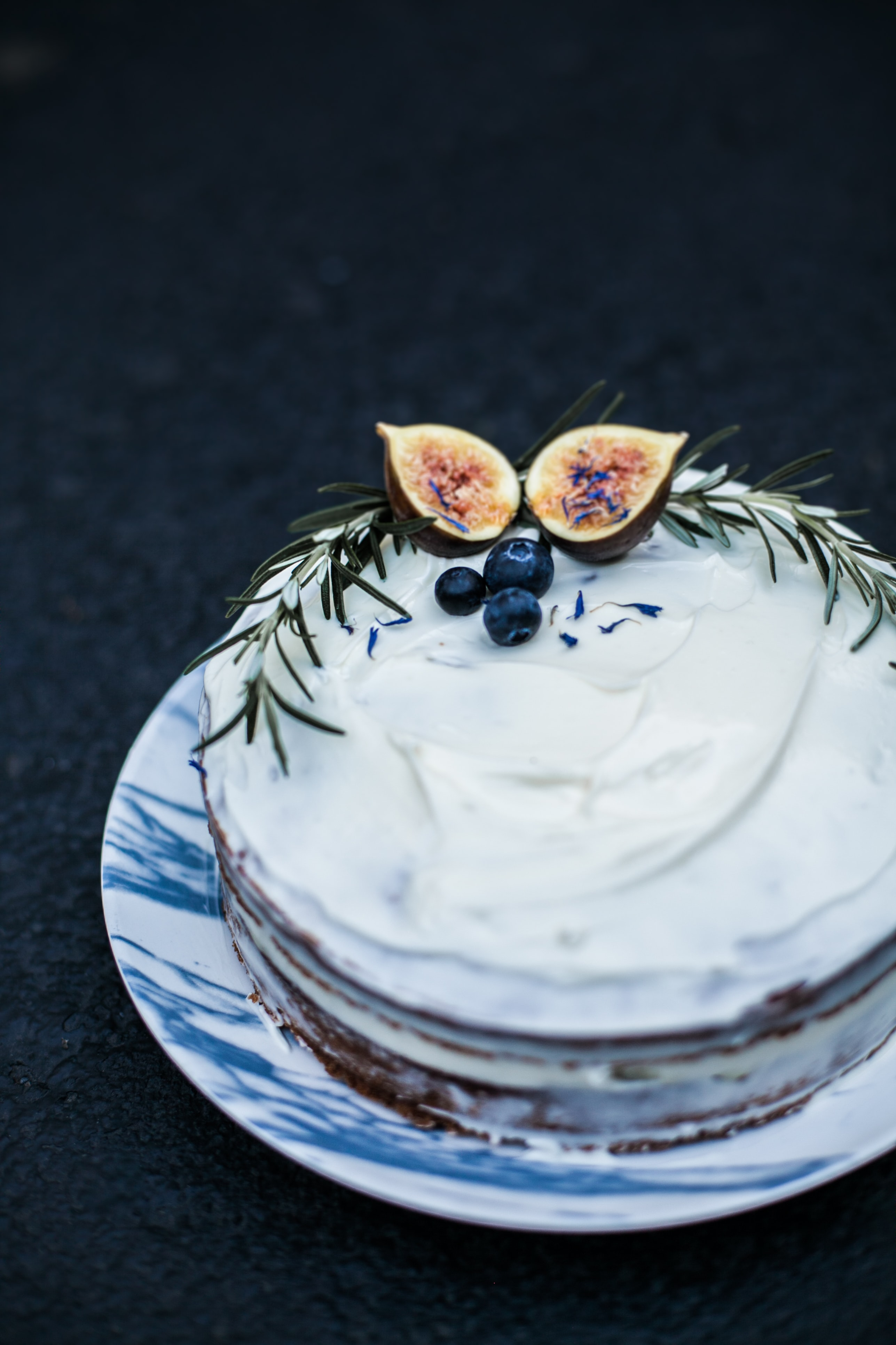 white and brown cake on top of white and blue plate