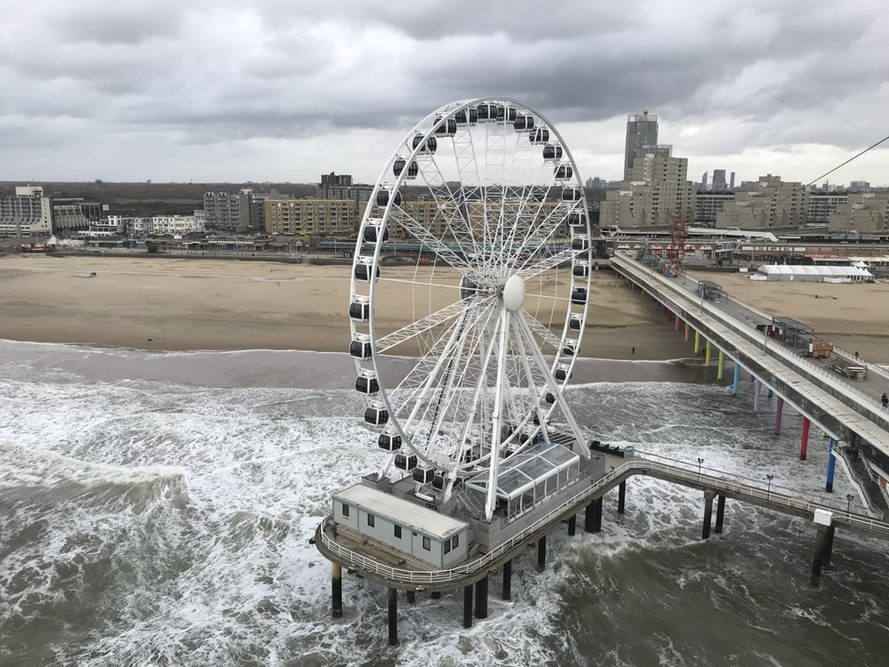 Ferris wheel on structure near beach