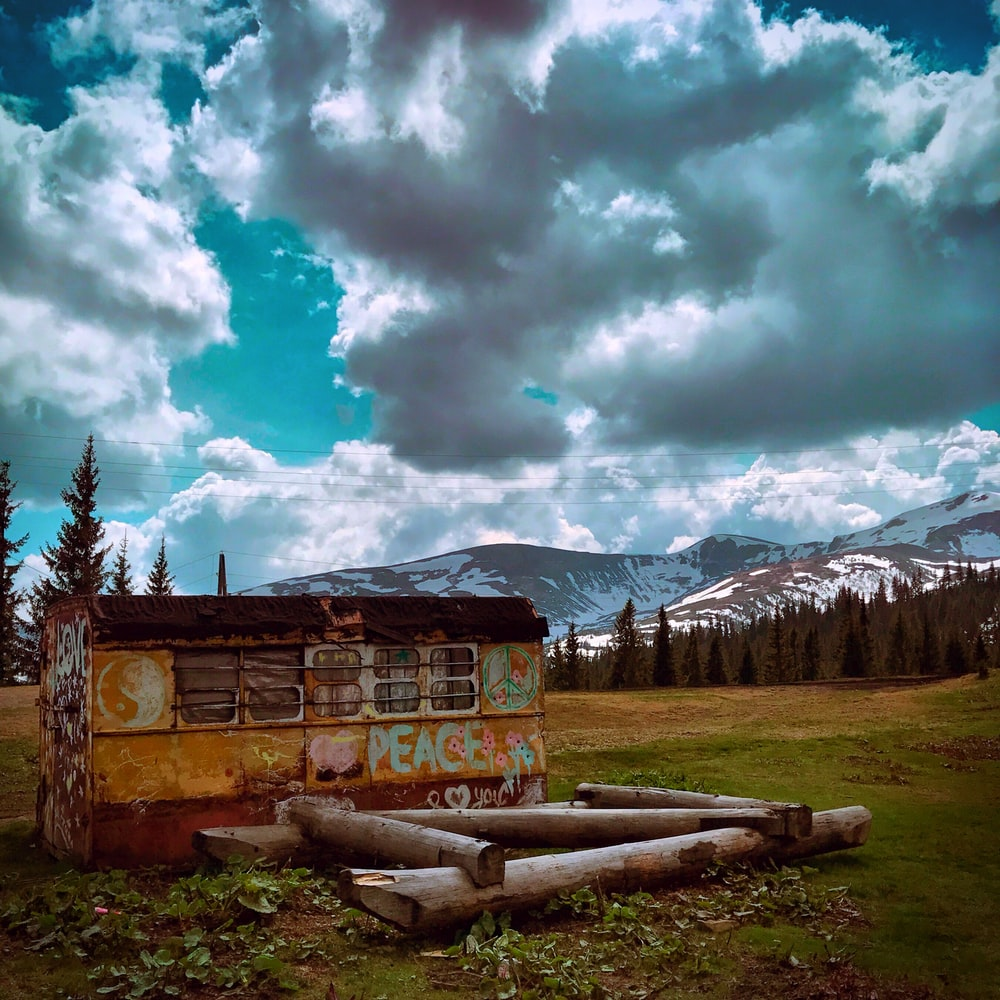 orange and red shed under white clouds