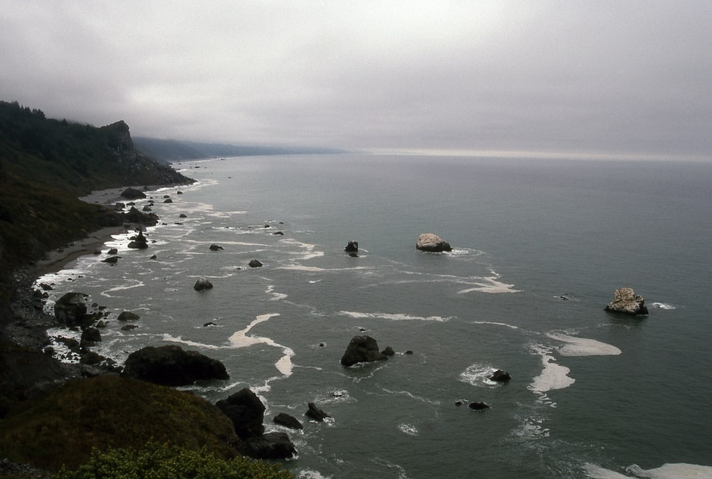 coastal rocks under gray skies