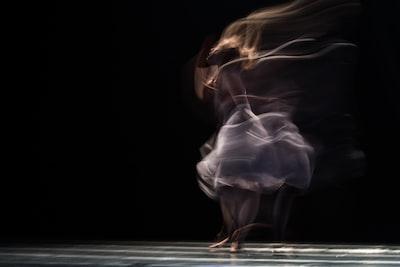 dancing woman on concrete pavement performance art teams background