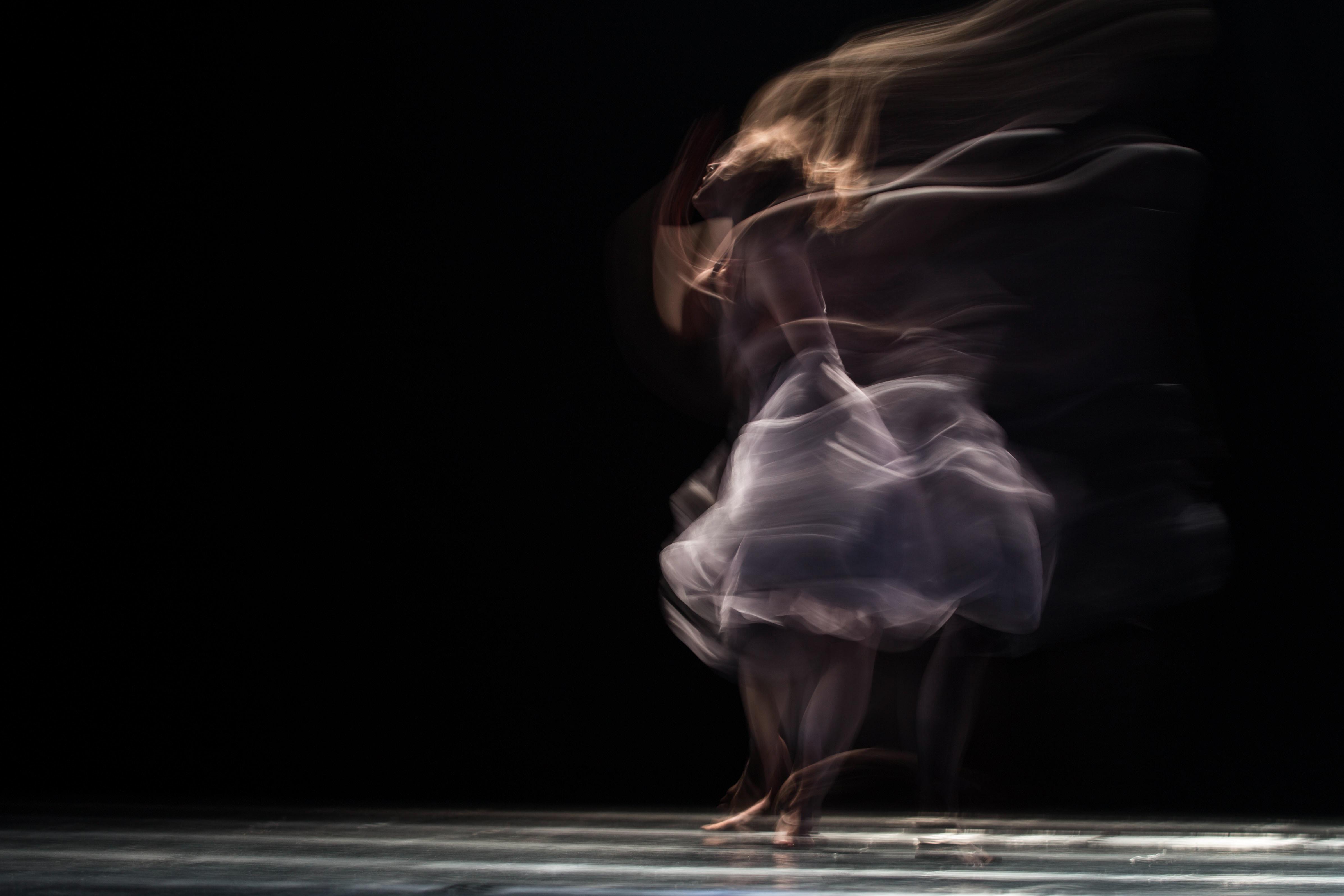 dancing woman on concrete pavement