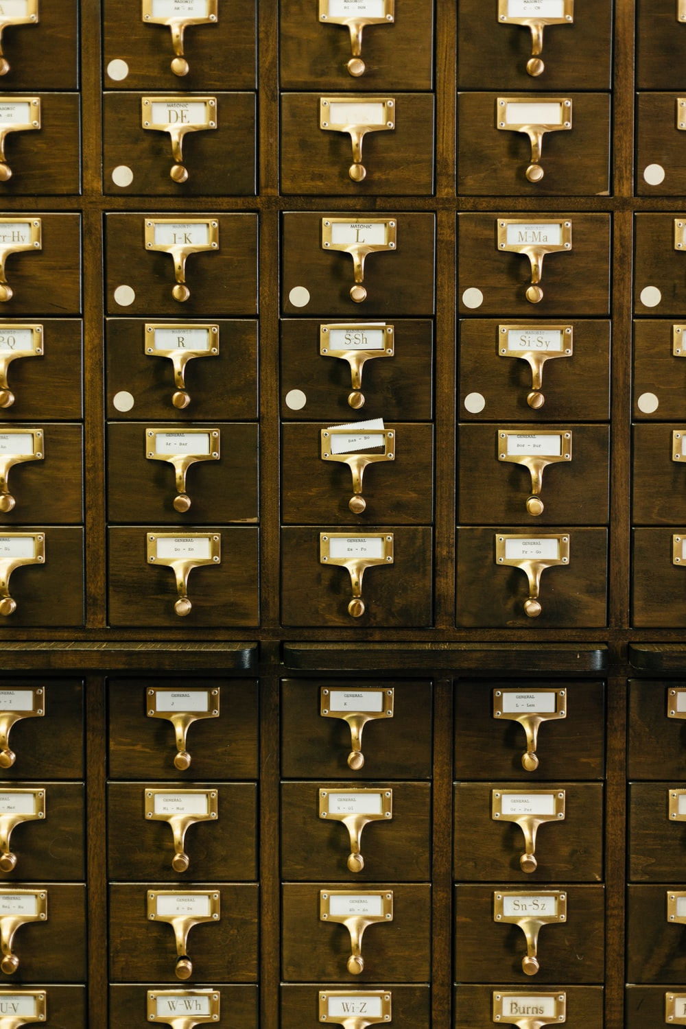 close-up photography of brown wooden card catalog
