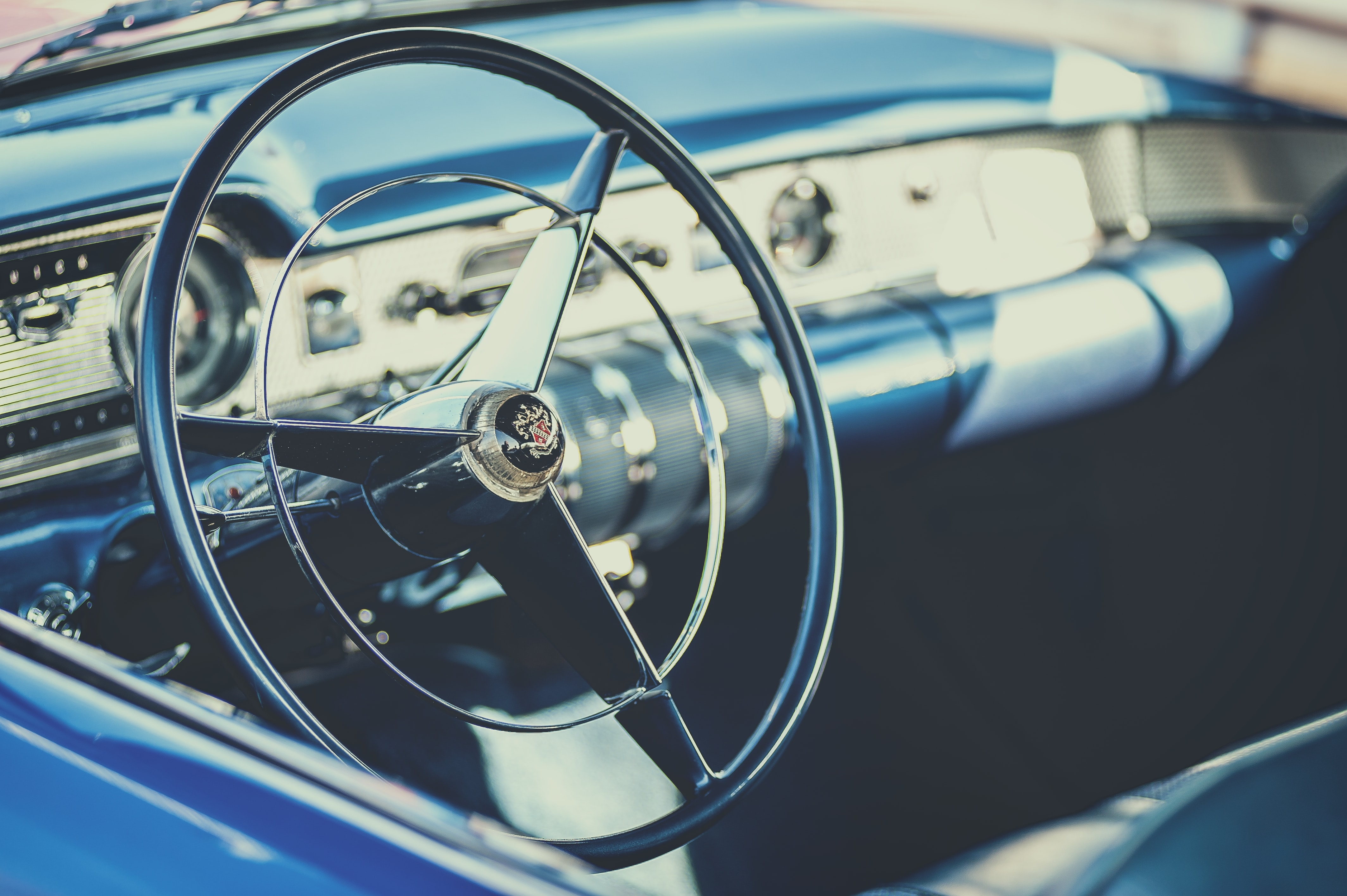 selective focus photography of car steering wheel