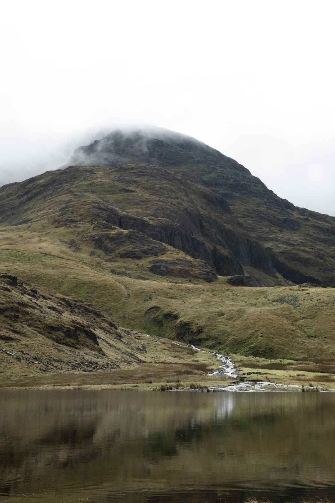 Out for a hike around Seathwaite towards Sprinkling tarn - started in mist and light rain.  When we got to Sprinkling tarn the mist lifted and rain sort of stopped allowing us a view of the hills we had not seen all day.  Always worth the effort.  No soul around, at peace and calm.