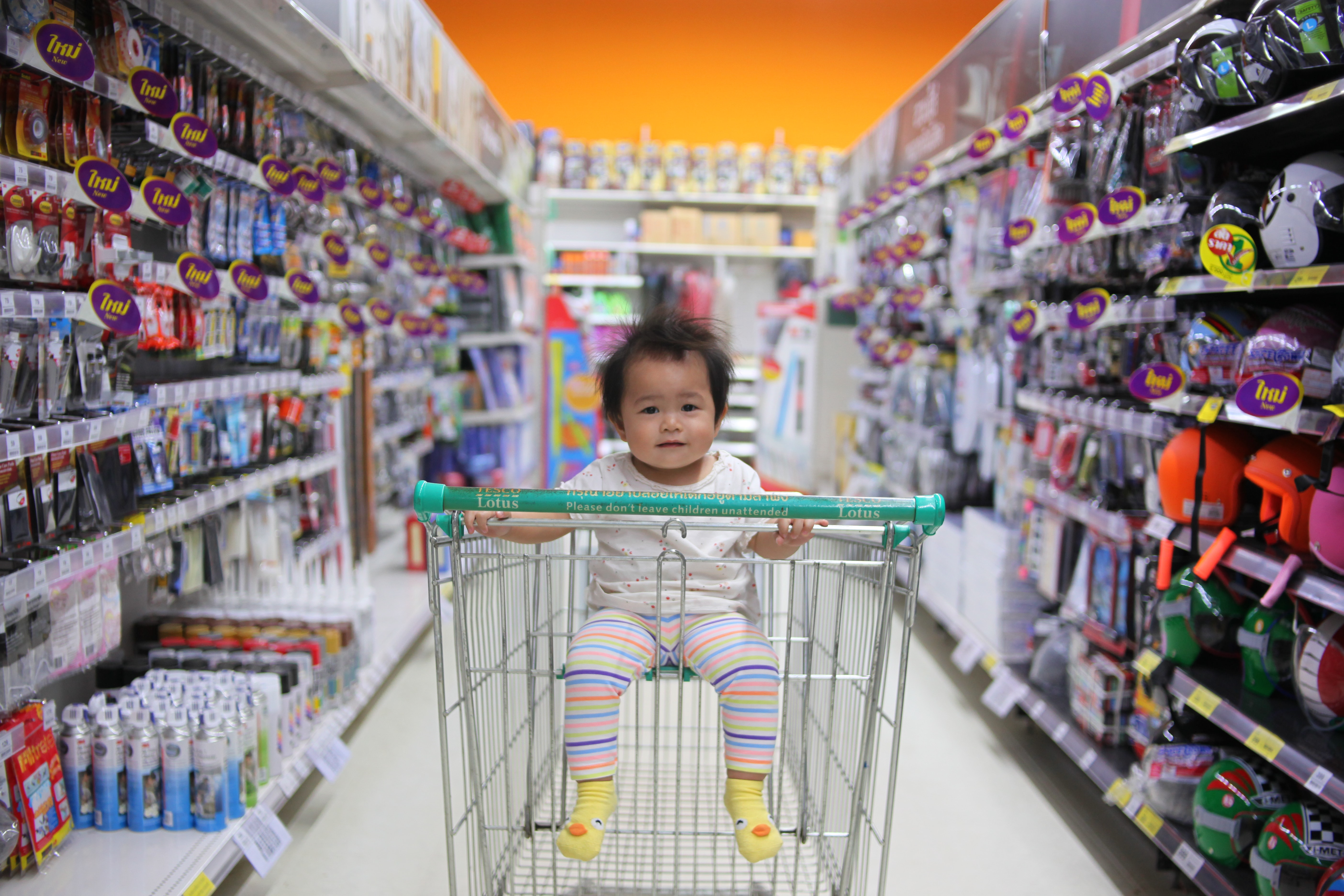 baby on white shopping cart
