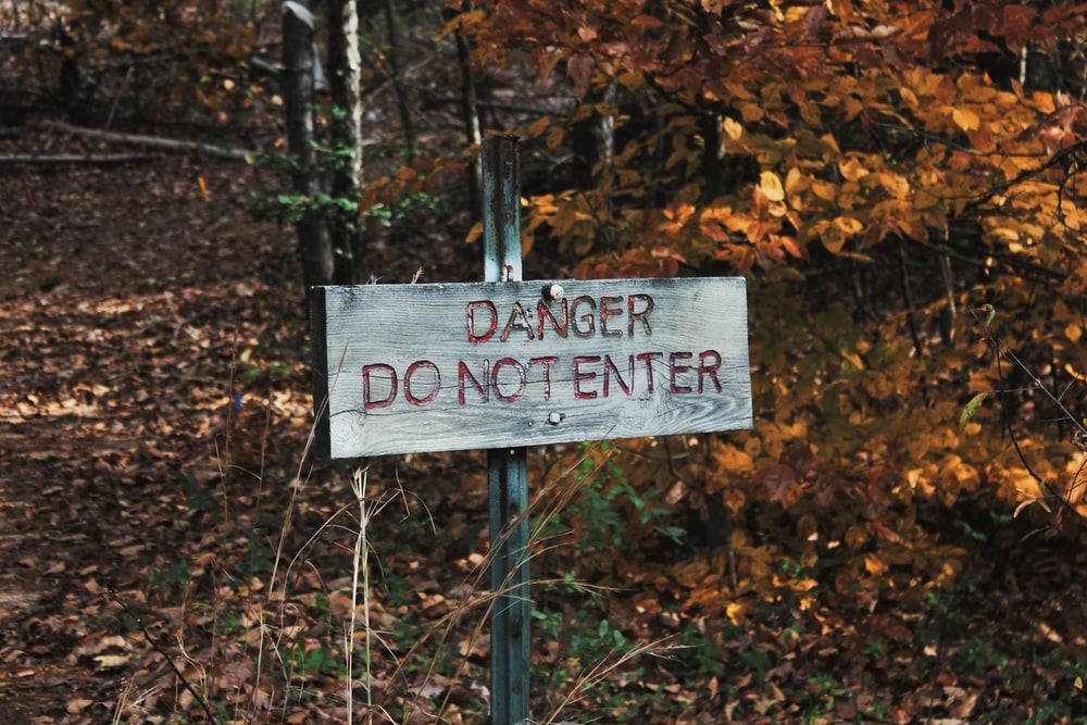 photo of gray danger do not enter signage