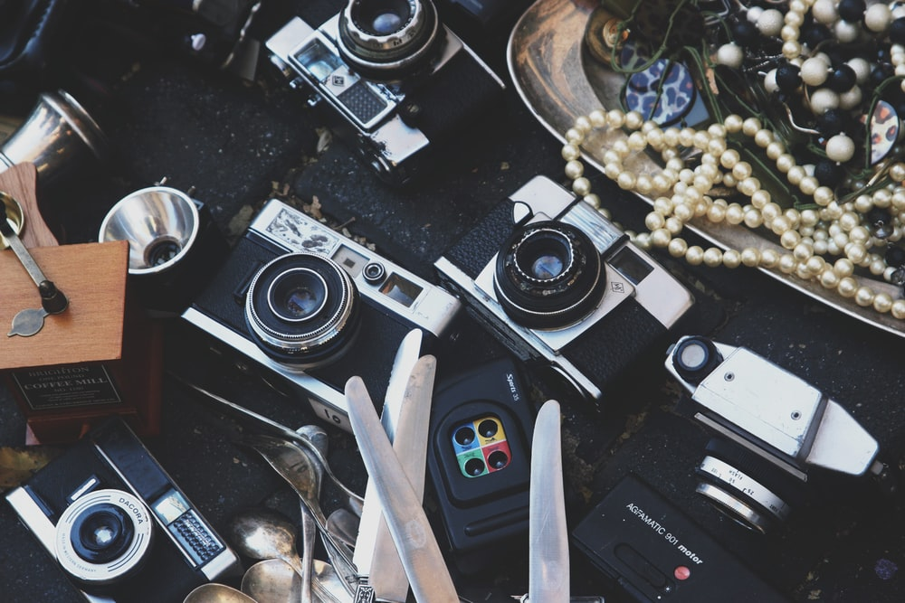 assorted cameras and jewelries