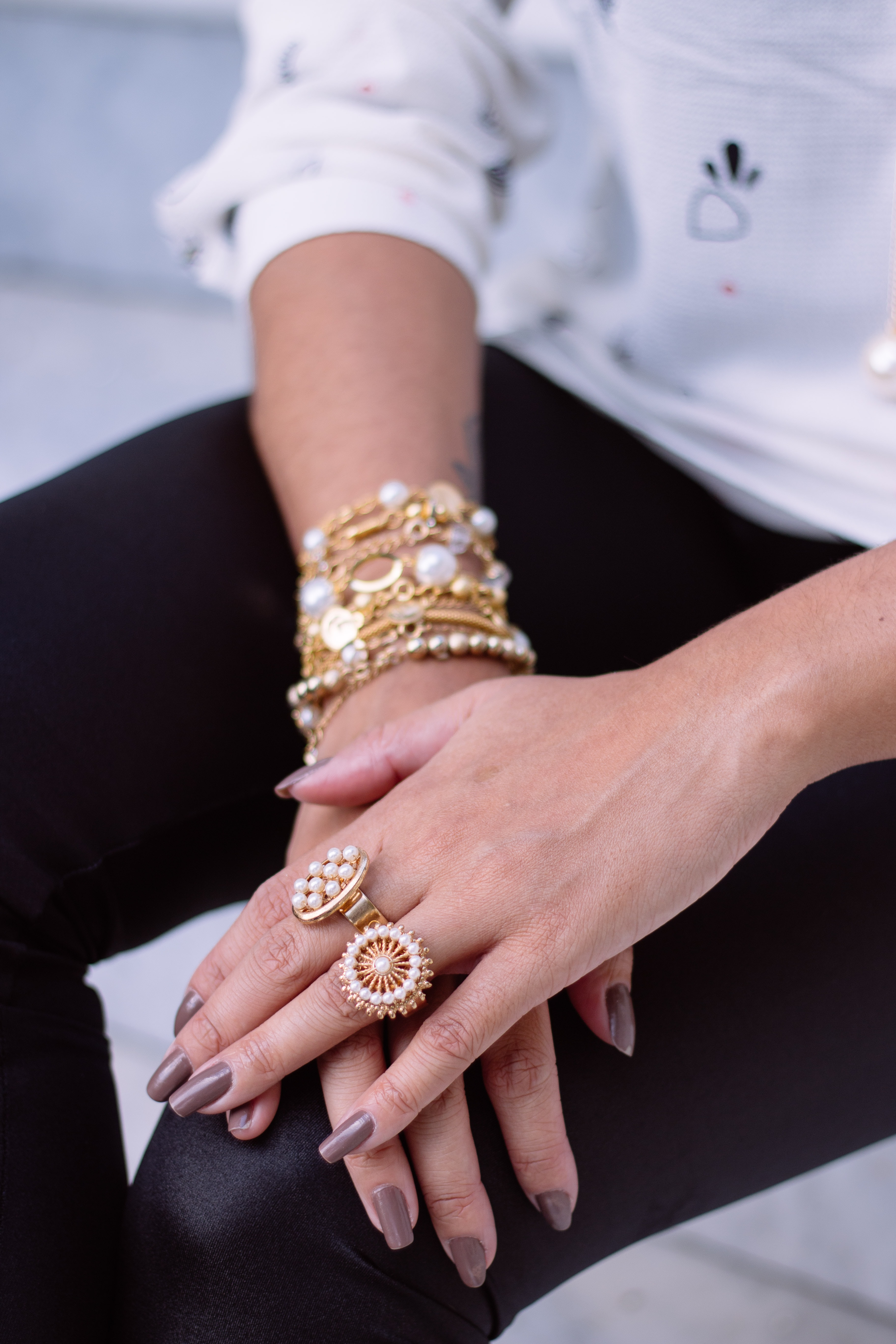 two white pearl encrusted gold-colored rings