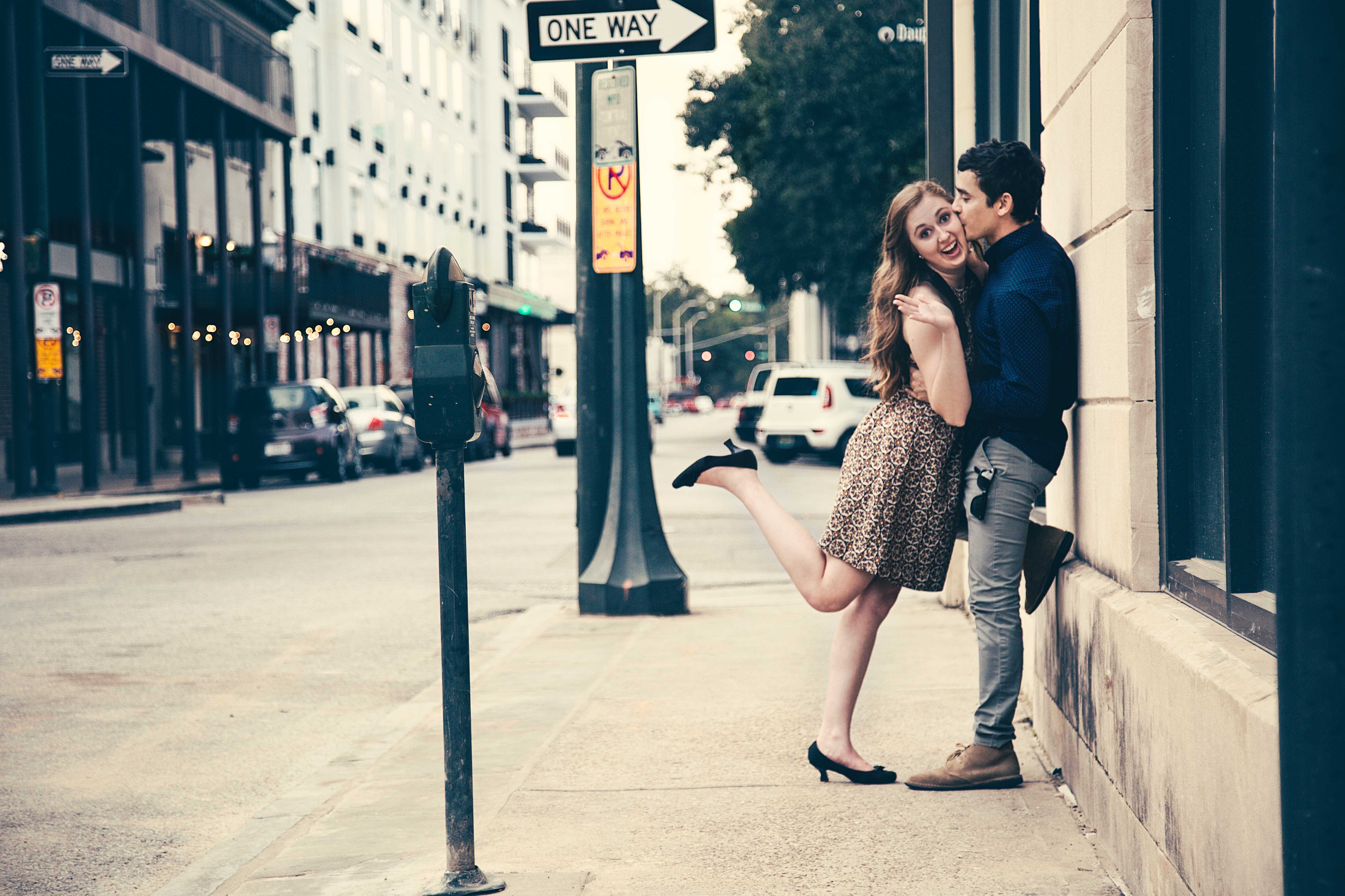 man kissing woman on street