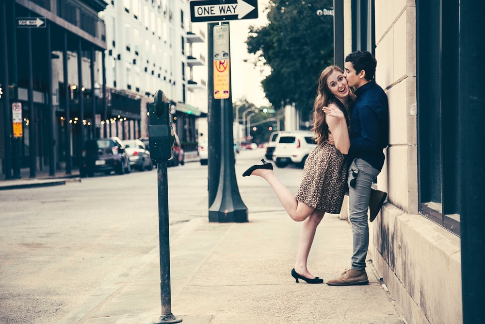 man kissing woman on street