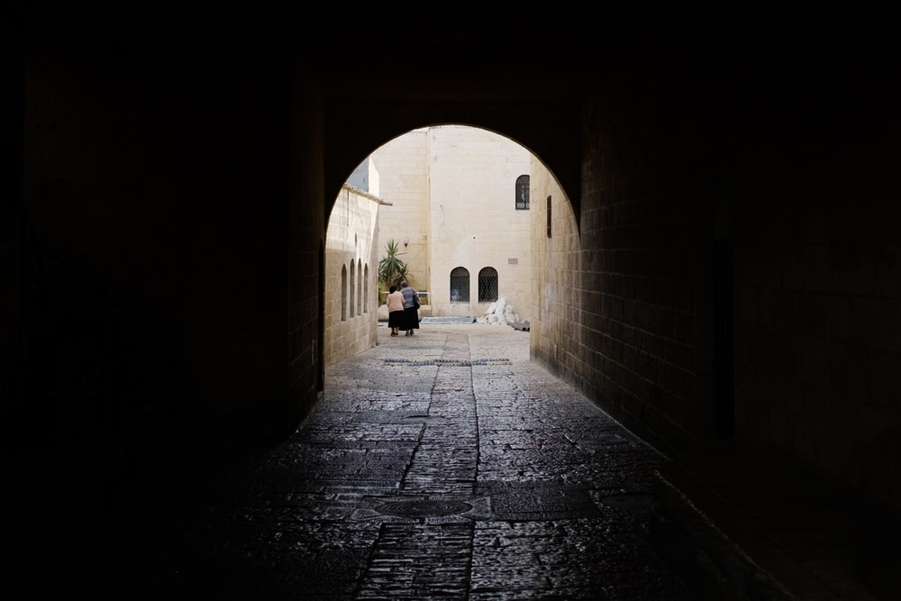black concrete pathway between buildings