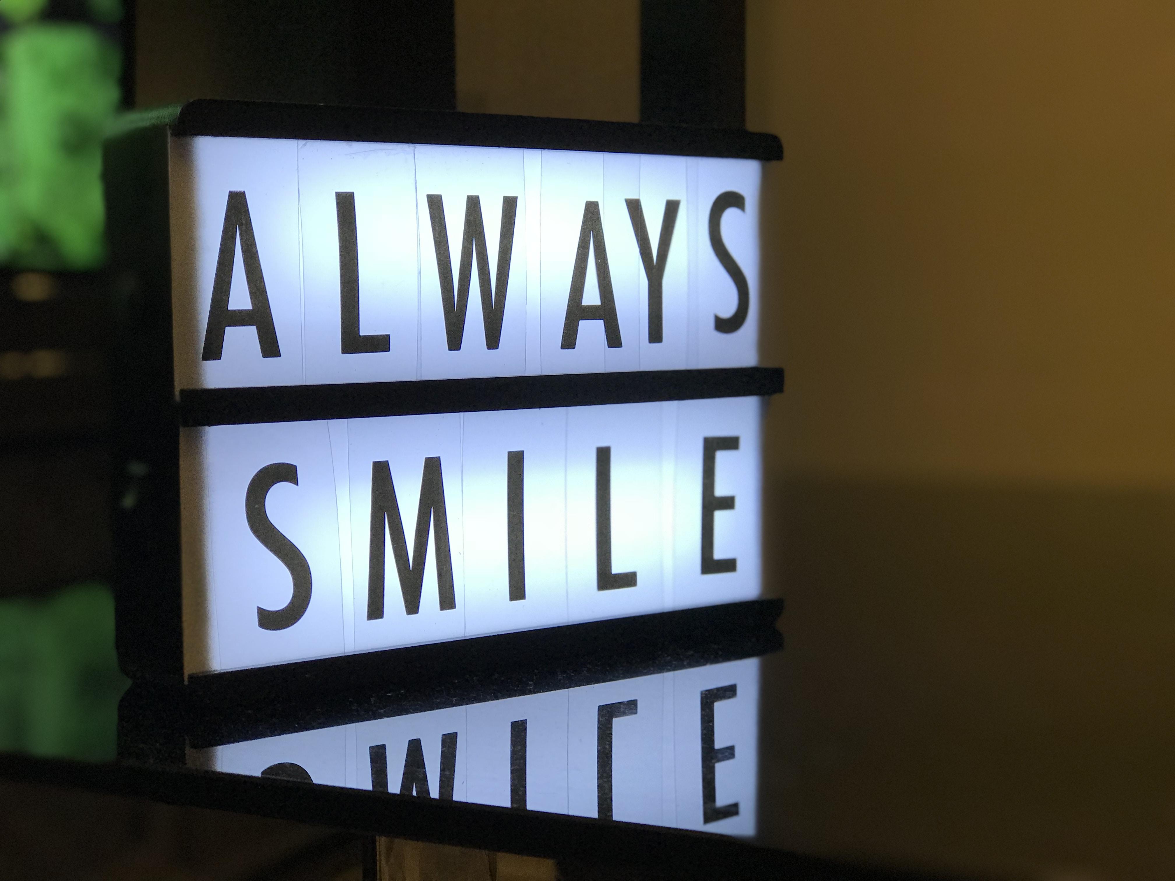 turned on Always Smile LED signage