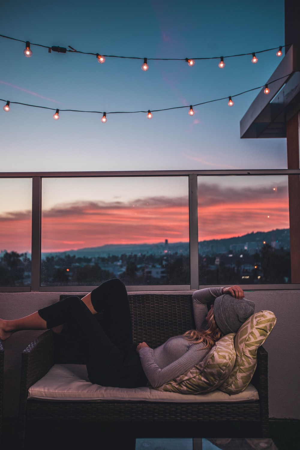 woman lying on sofa in rooftop